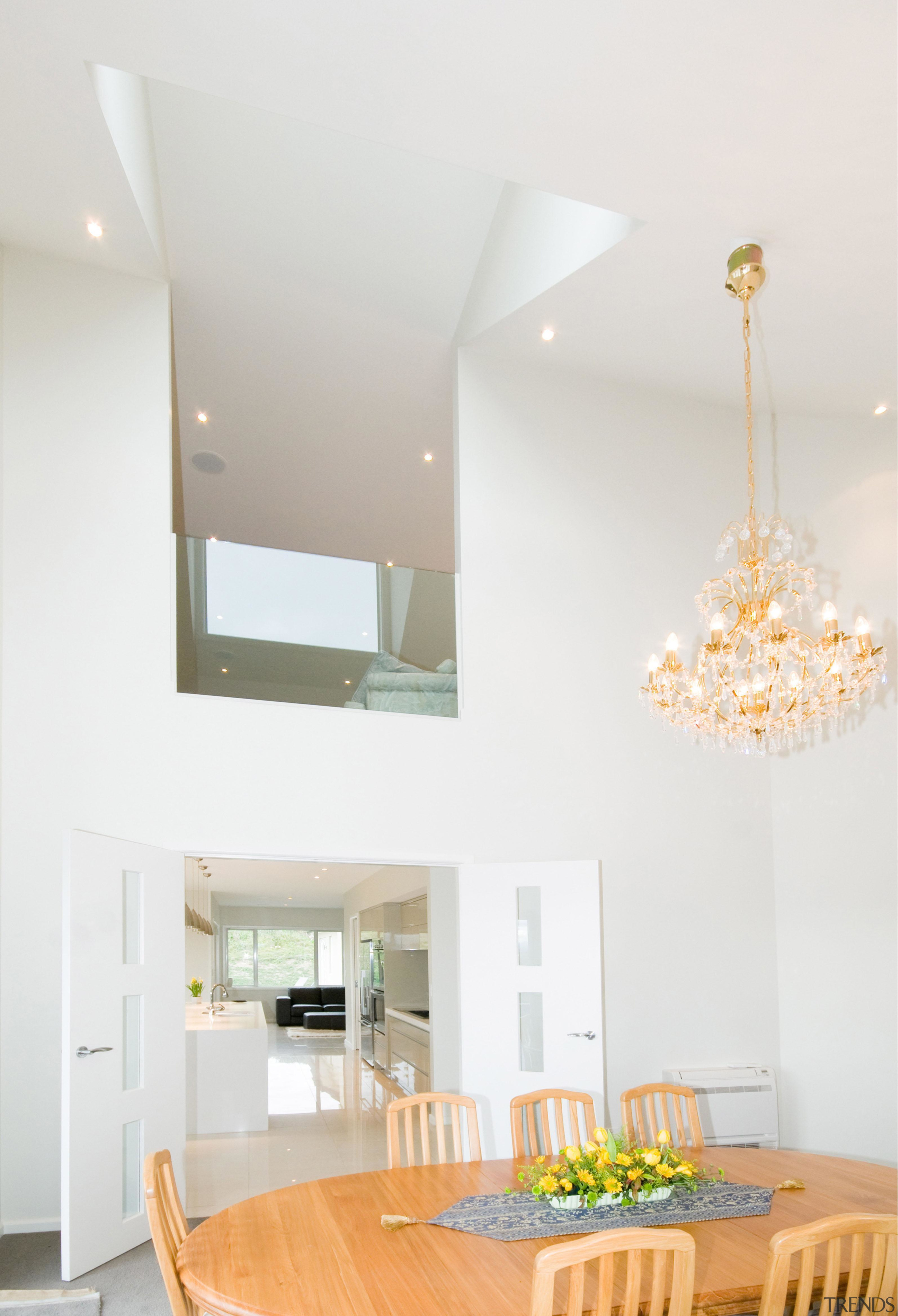 White open dining area with wooden furniture ceiling, home, house, interior design, light fixture, lighting, living room, table, white