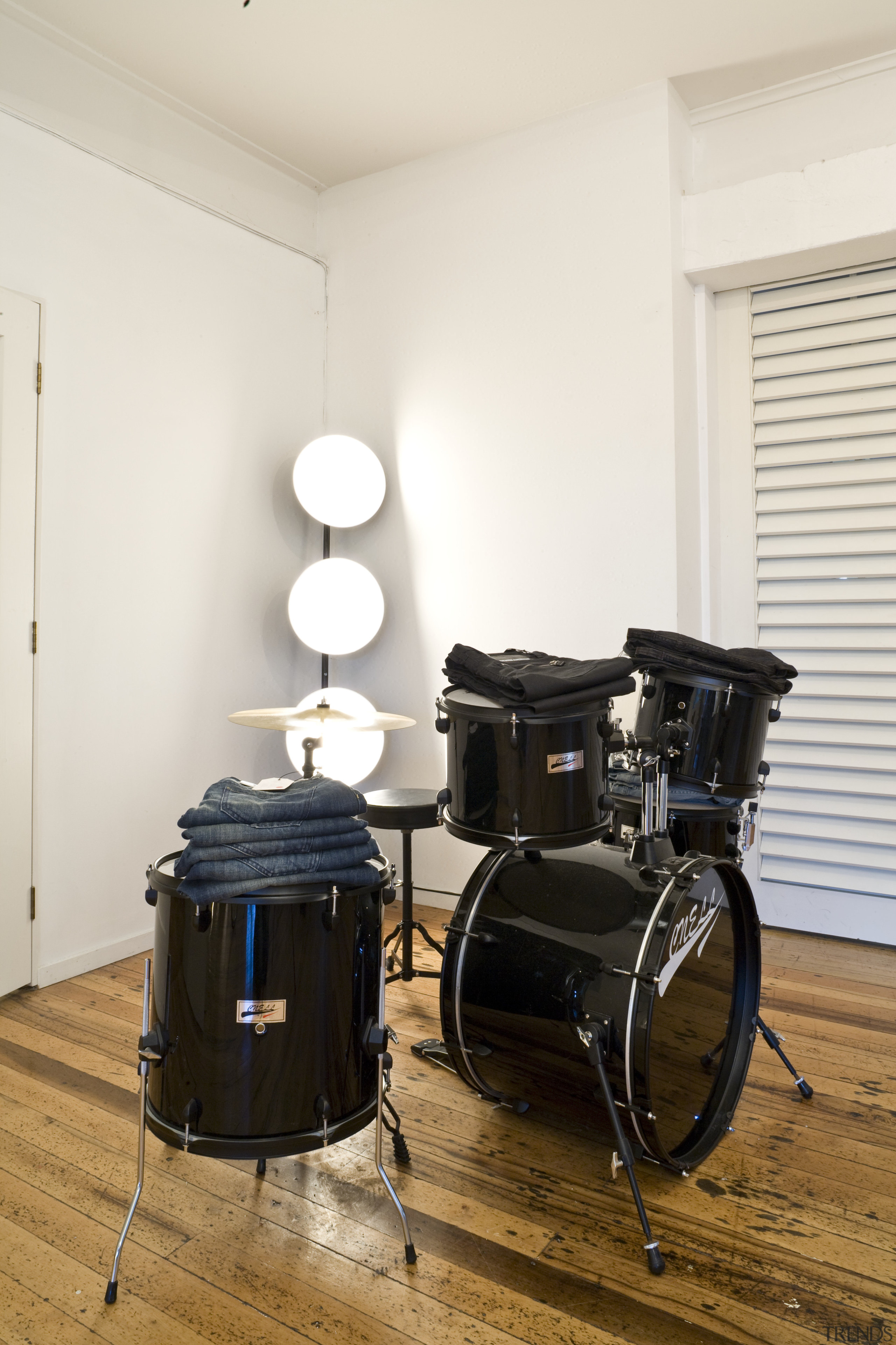 View of a drum kit which is used cymbal, drum, drums, musical instrument, percussion, skin head percussion instrument, table, timbales, tom tom drum, white