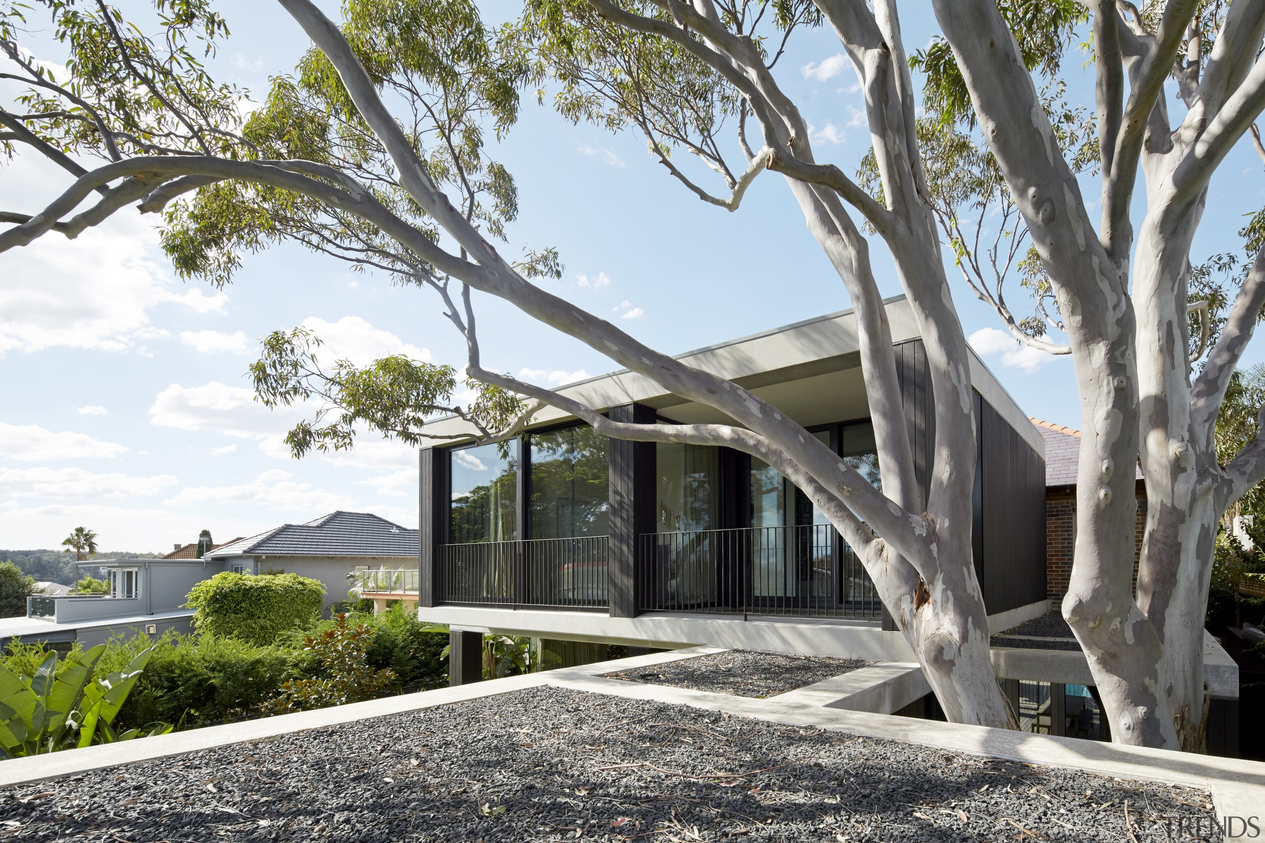The upper-level master suite on this extension opens architecture, building, home, house, plant, property, real estate, residential area, tree, white