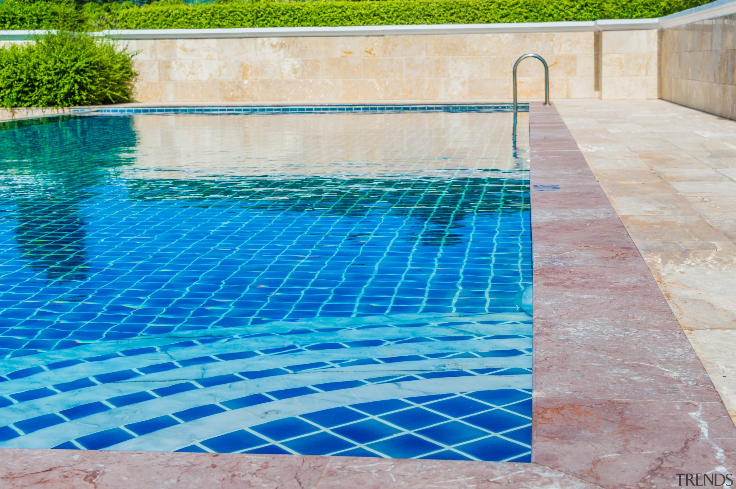 Going with concrete means you've near-unlimited material options aqua, area, composite material, fence, floor, flooring, leisure, leisure centre, net, property, road surface, swimming pool, tile, wall, water, water feature, water resources, gray, teal