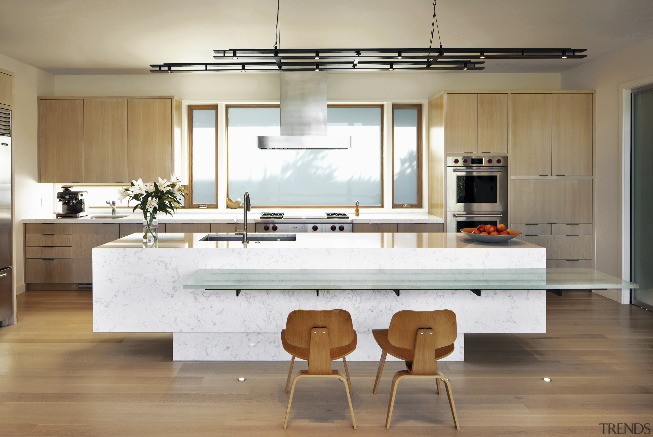 Architect Nils Finne prefers to select subtle materials architecture, bar stool, cabinetry, countertop, glass benchtop, timber floor, furniture, home, house, interior design, kitchen, lighting, plywood, sink, Nils Finne, Finne Architects