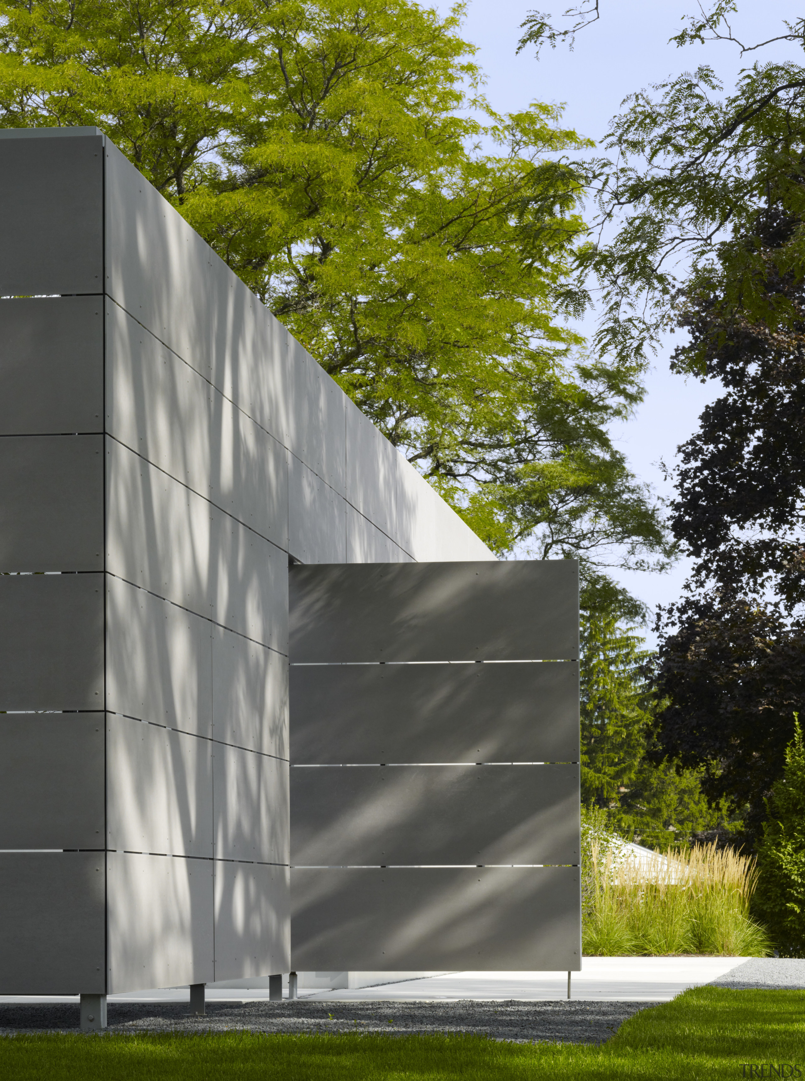 Cement panels form a large door that can architecture, building, daytime, facade, grass, house, pavilion, sky, structure, tree, brown, black, gray