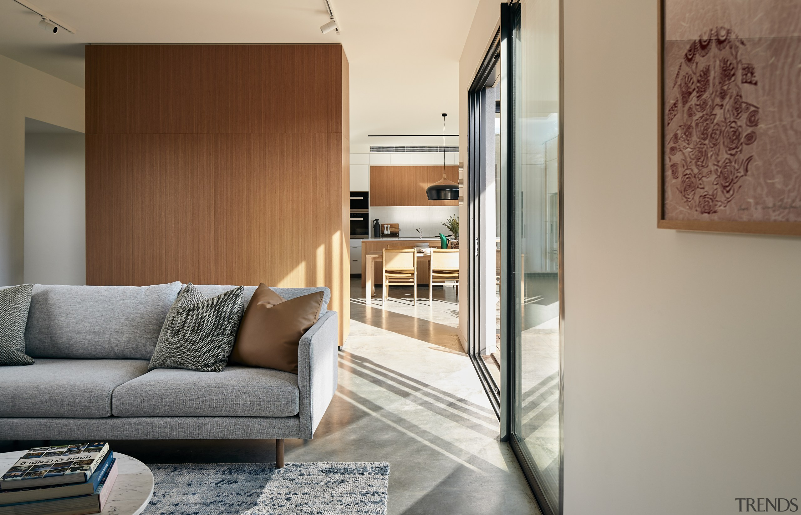 The home has a natural ambience with plenty apartment, architecture, automotive exterior, building, door, floor, furniture, glass, home, home door, house, interior design, living room, property, real estate, room, sliding door, table, vehicle door, wall, gray, brown