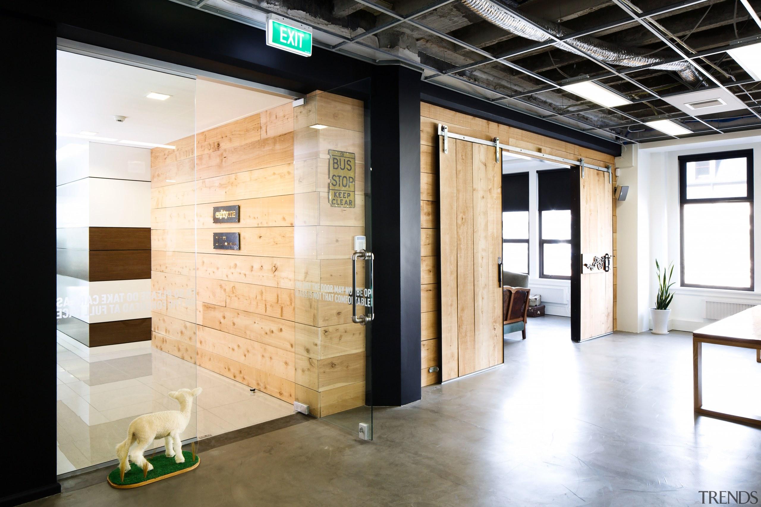 The meeting room, beside the entry to EightyOne, floor, flooring, interior design, white, black