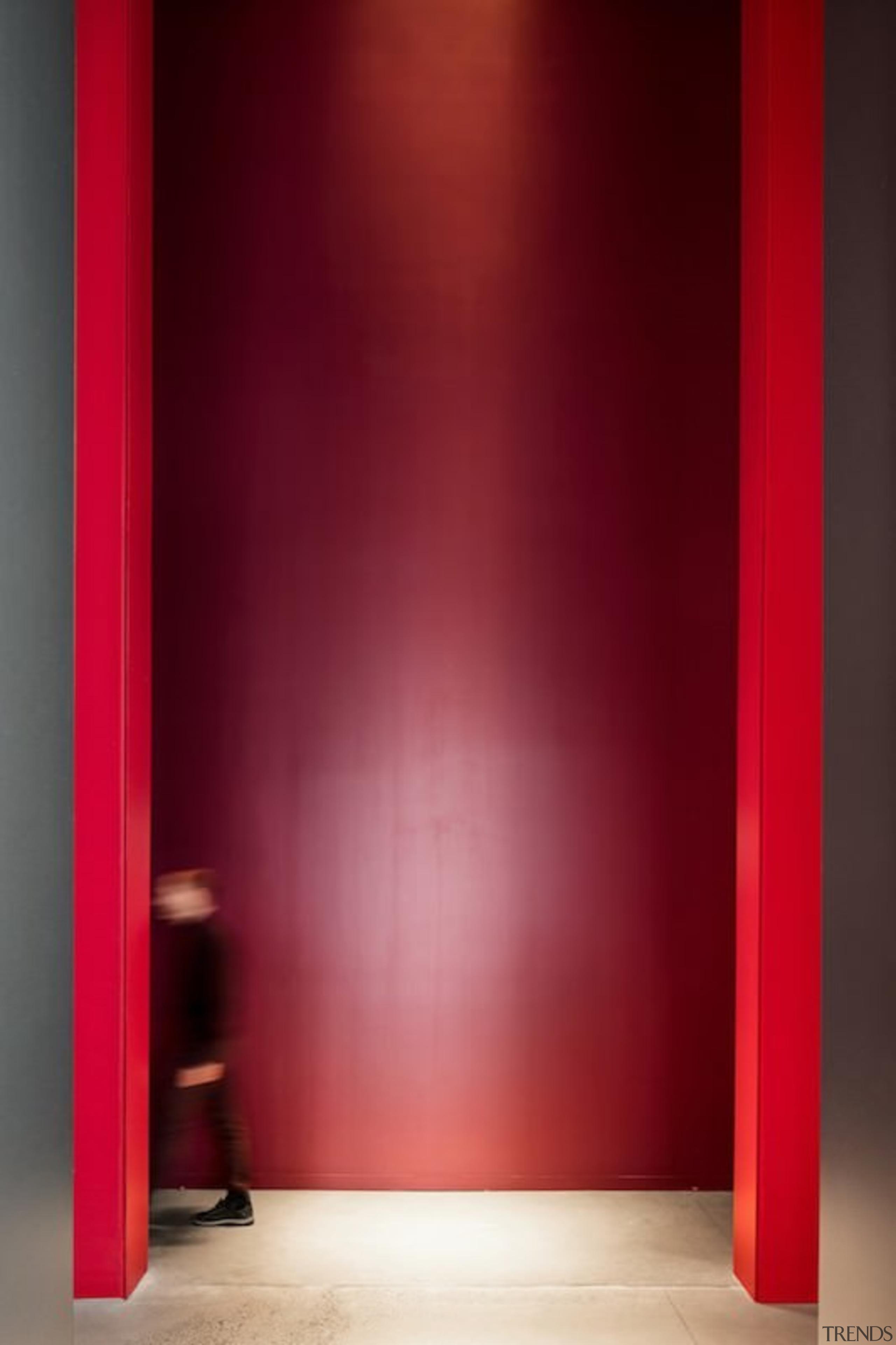 This massive doorway is certainly imposing - This door, floor, interior design, light, lighting, red, wall, red