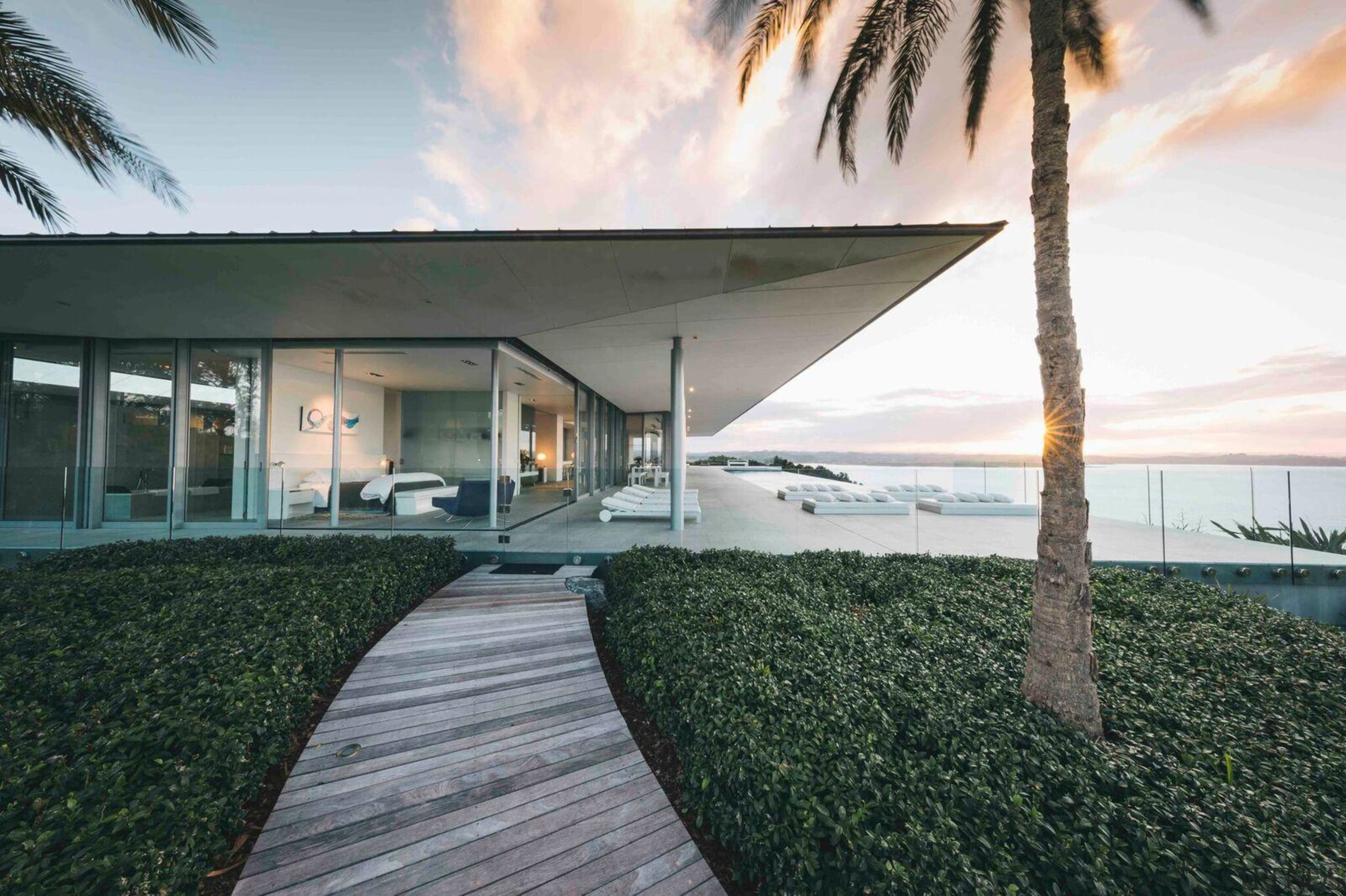 Eagles Nest, Bay of Islands, New Zealand - architecture, building, eco hotel, estate, facade, home, house, interior design, palm tree, property, real estate, resort, sky, tree, vacation, villa, gray, white