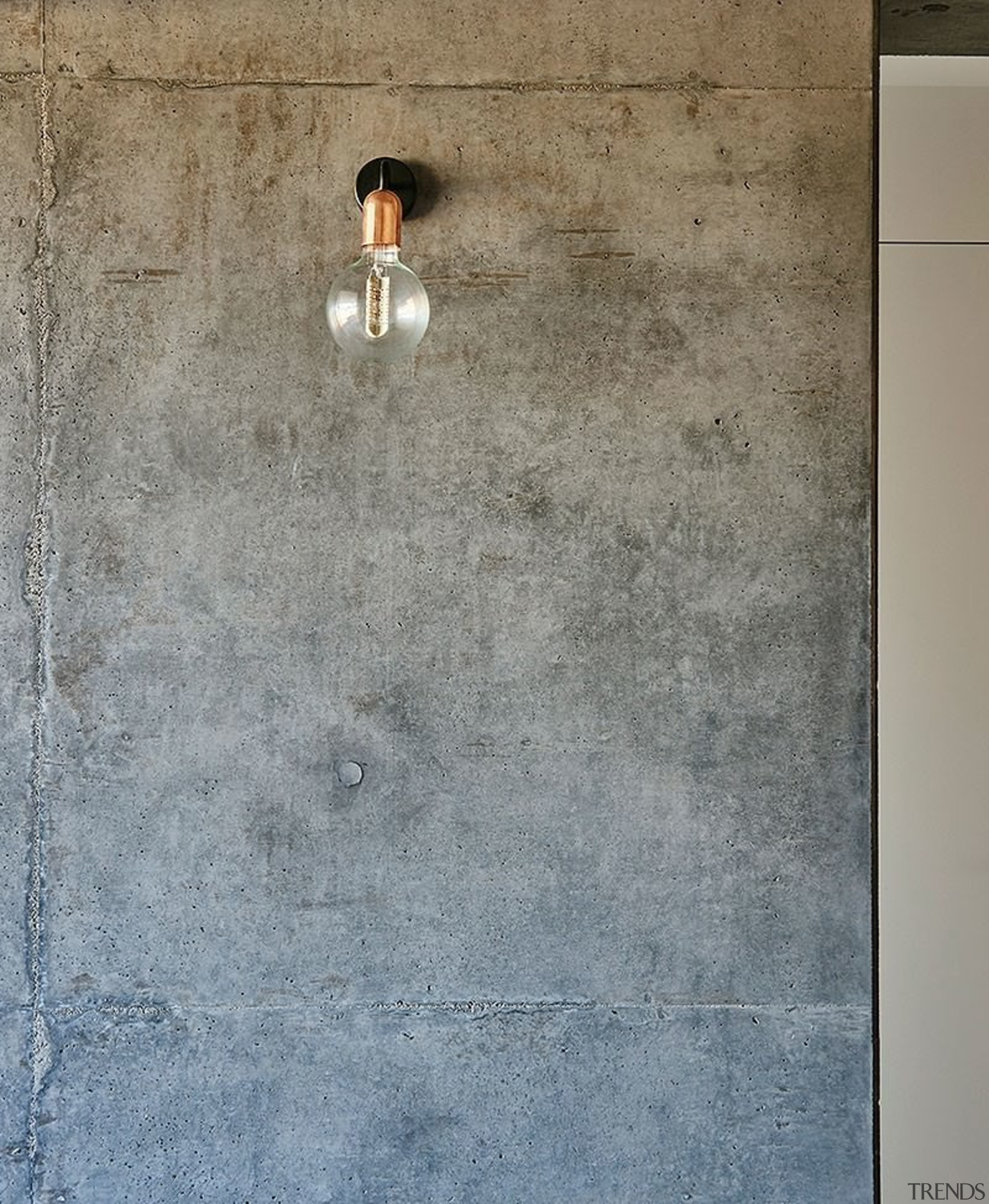 A lone light juts out from the concrete concrete, floor, plaster, texture, wall, gray