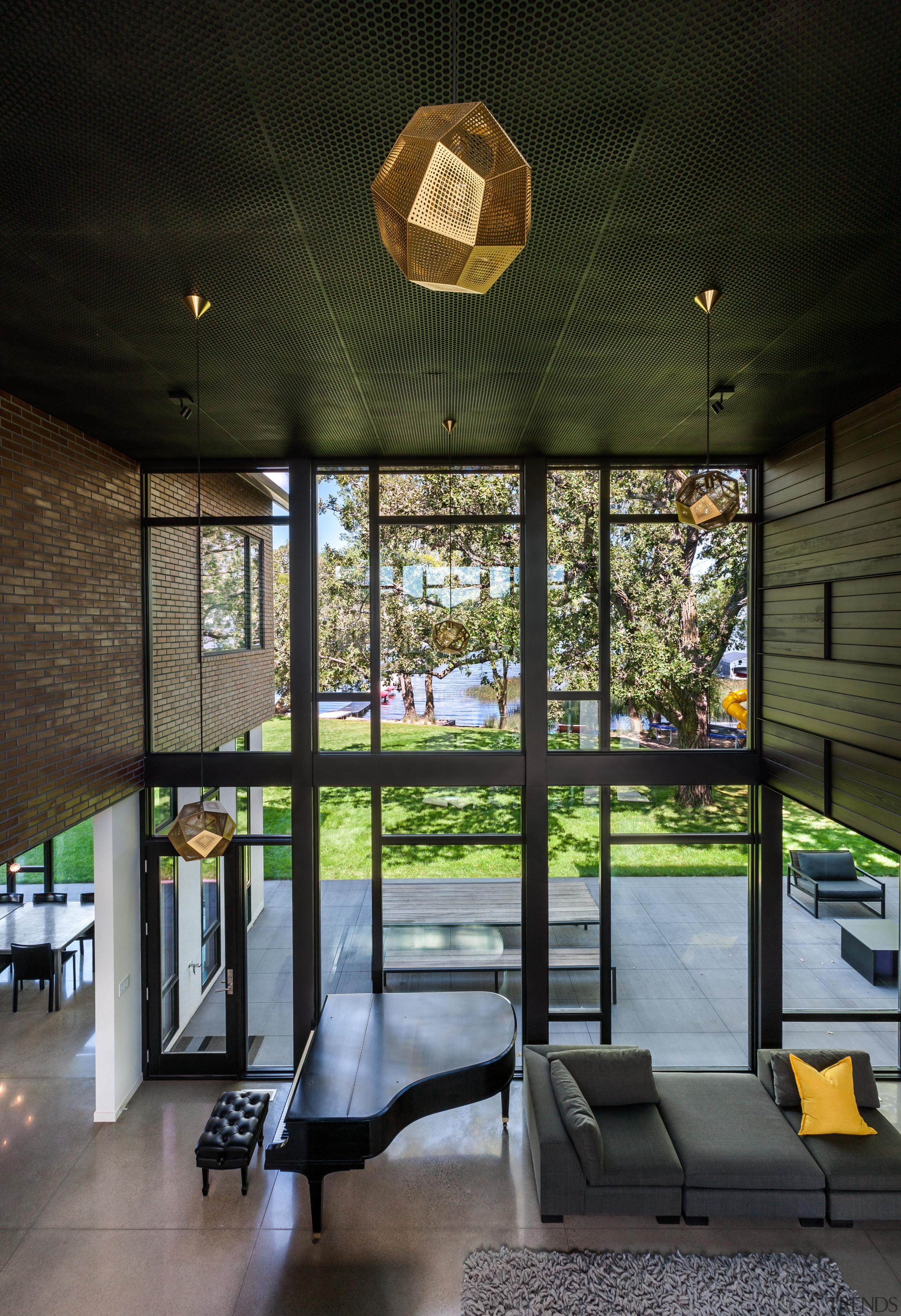 Despite the hard surfaces such as the concrete architecture, home, house, interior design, lobby, black, piano, windows, lighting, Altus Architecture