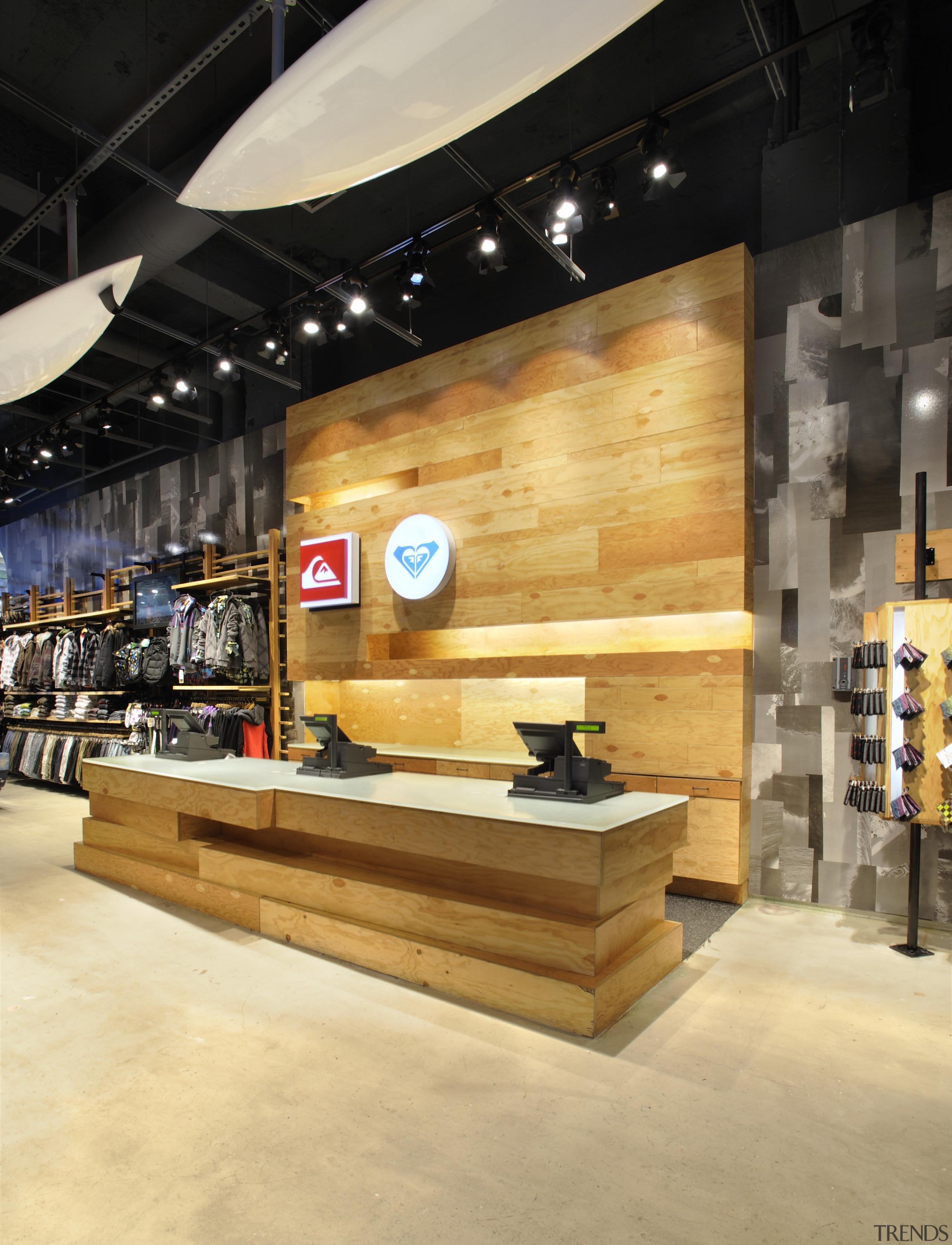 Interior view of the Quicksilver store in New interior design, retail, shoe store, wood, orange, black