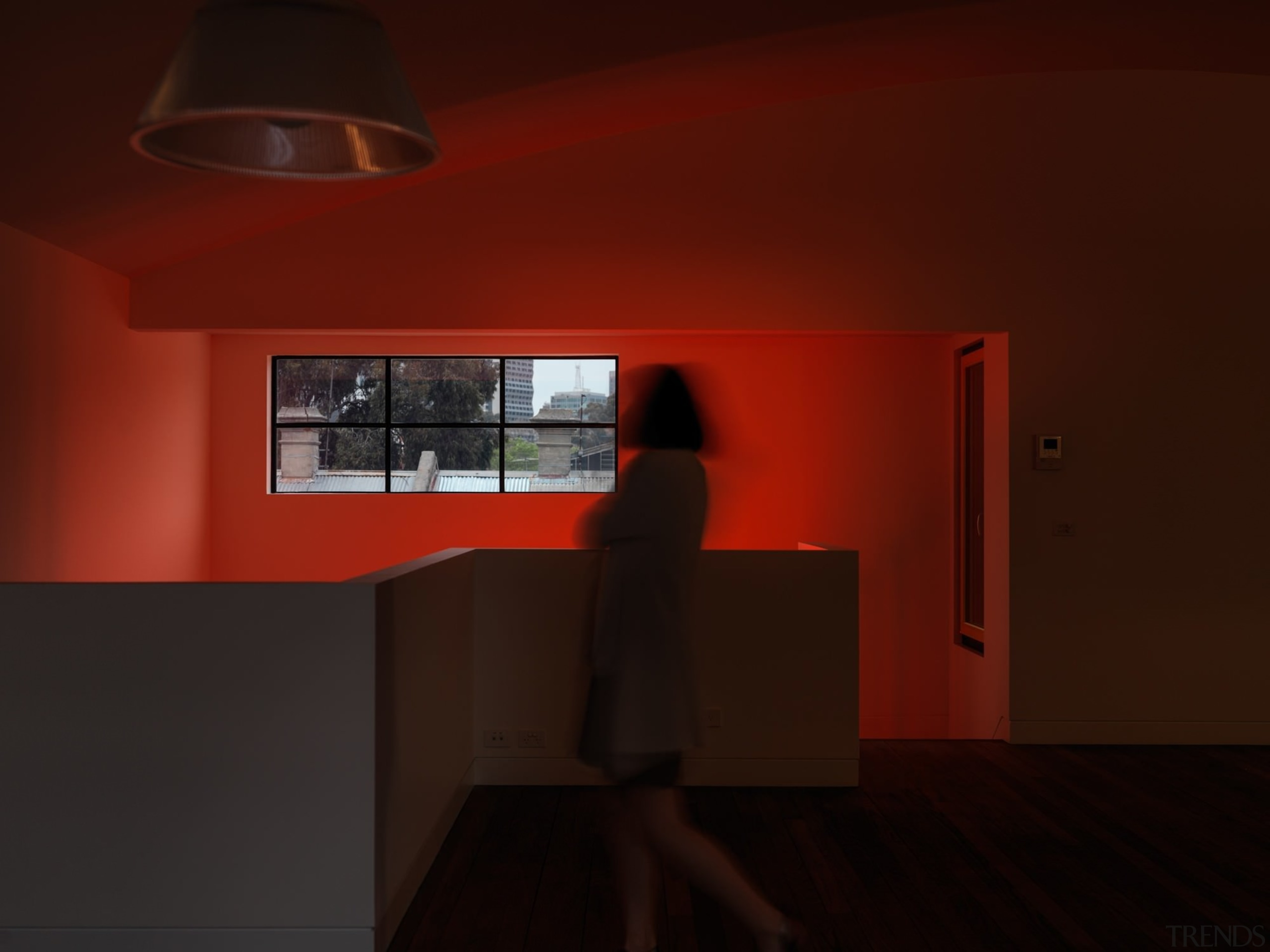 The red sign certainly stands out, even when architecture, ceiling, darkness, daylighting, furniture, house, interior design, lamp, light, light fixture, lighting, orange, product design, table, wall, red, black