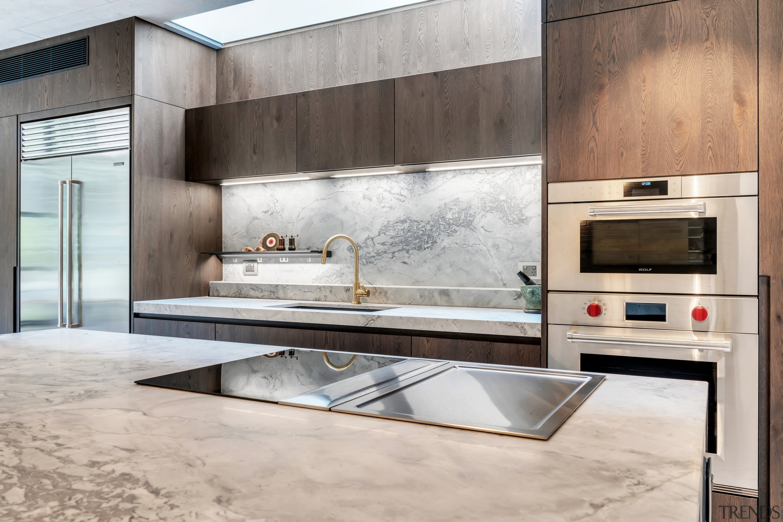 With recessed pulls, the refined cabinetry in this