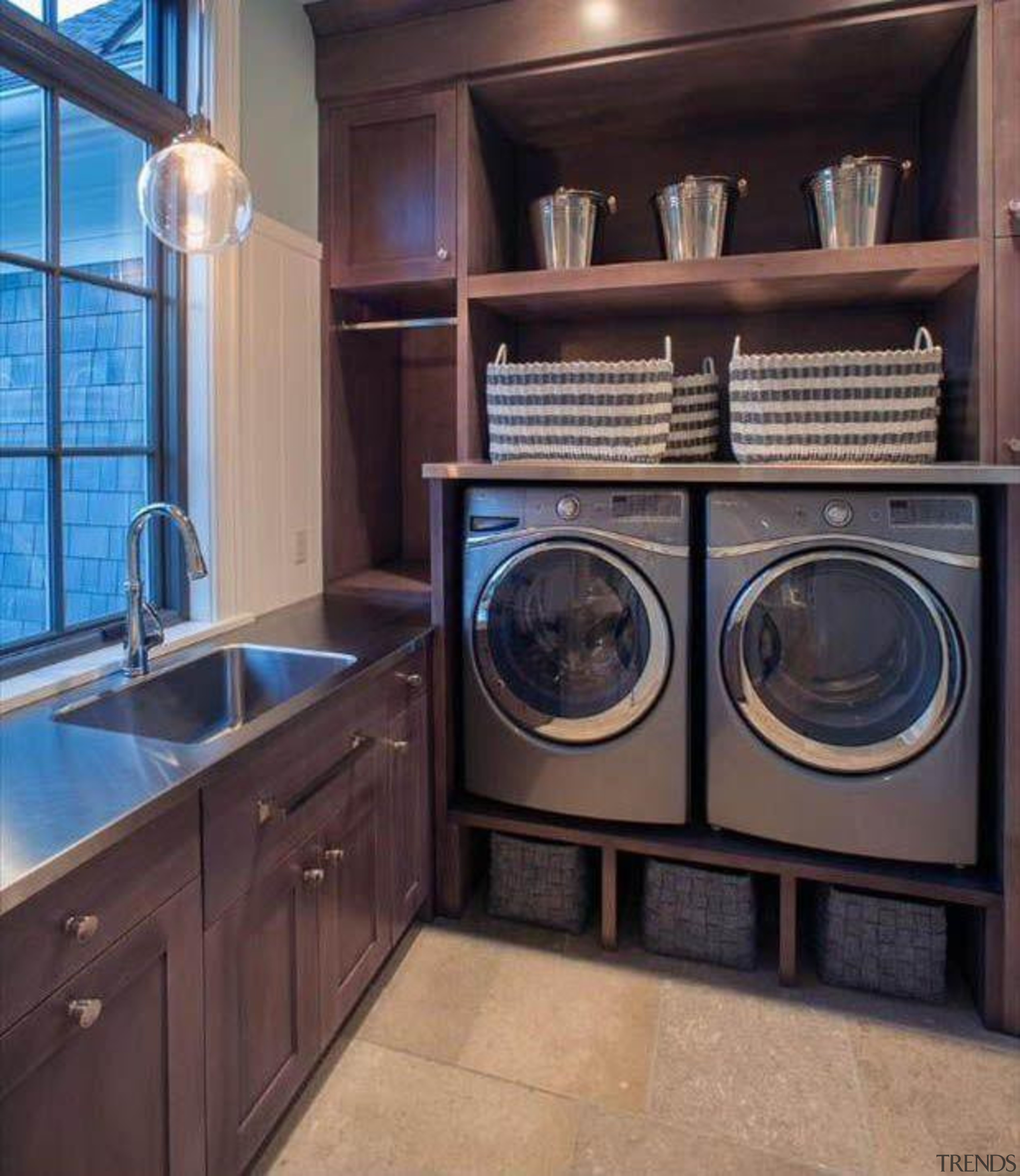 Utilitarian spaces such as laundry rooms and mudrooms cabinetry, countertop, home appliance, kitchen, laundry, laundry room, major appliance, room, washing machine, black