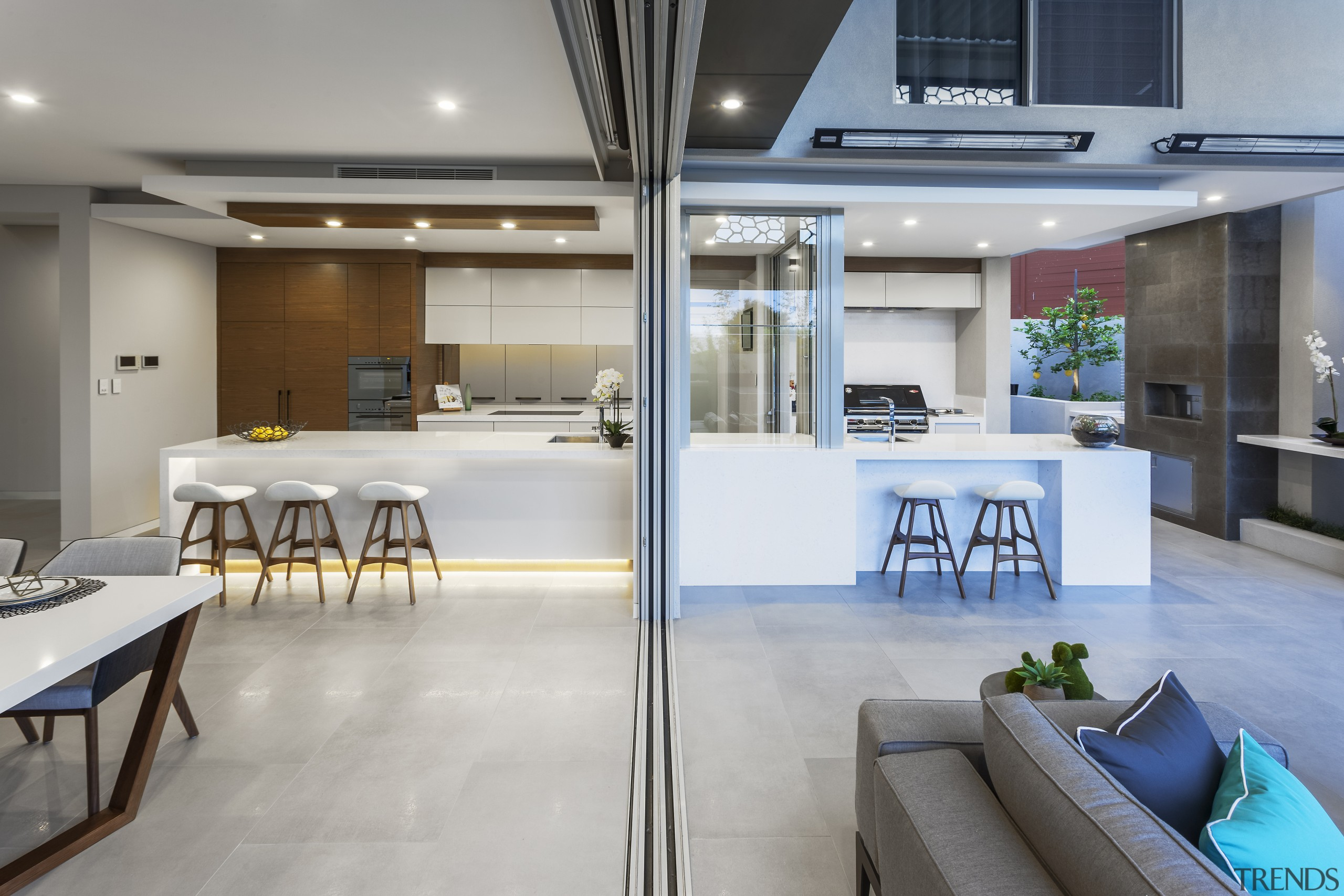 A dropped ceiling delineates the indoor kitchen in interior design, gray