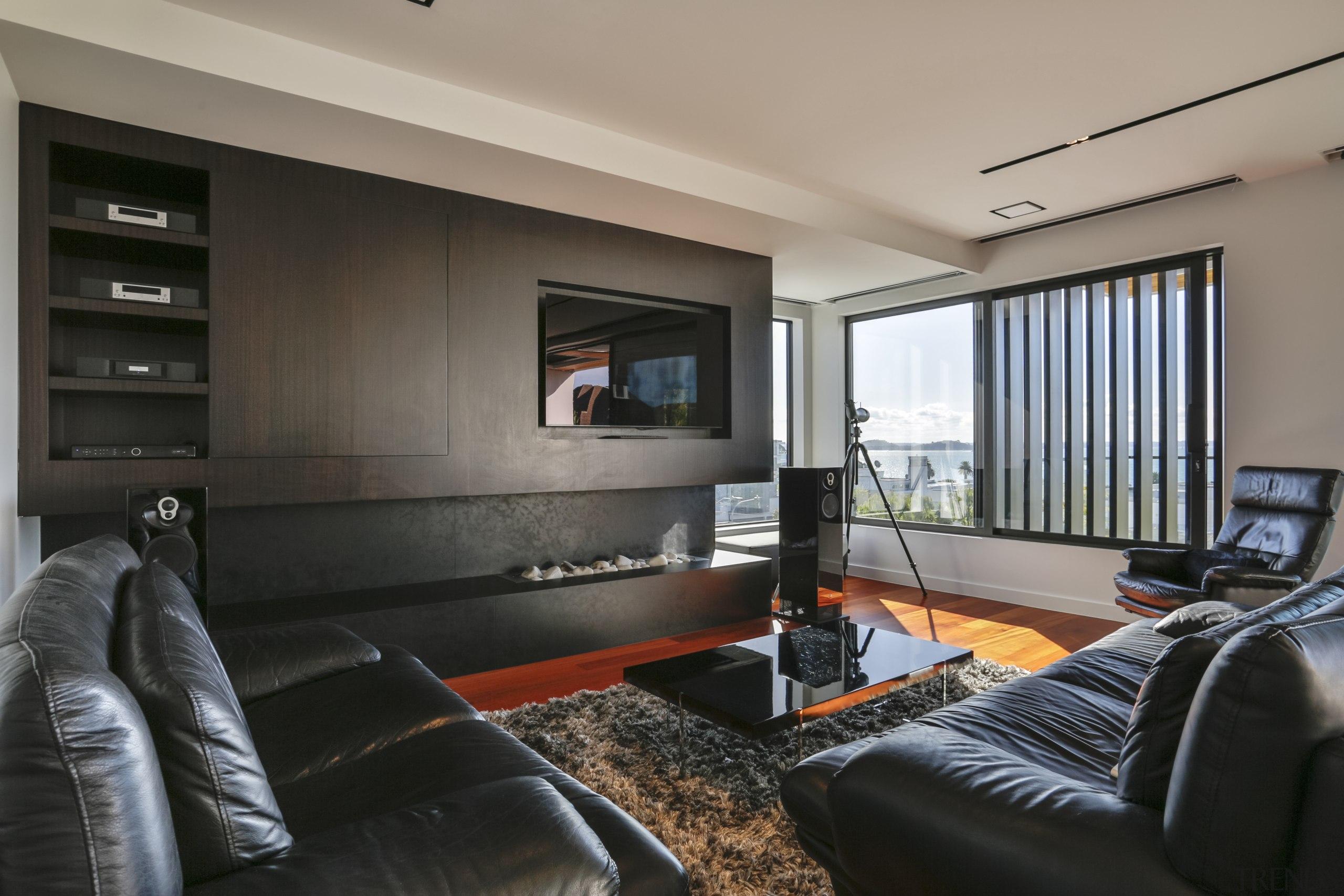 Dark living room cabinetry anchors the white, open gray, black