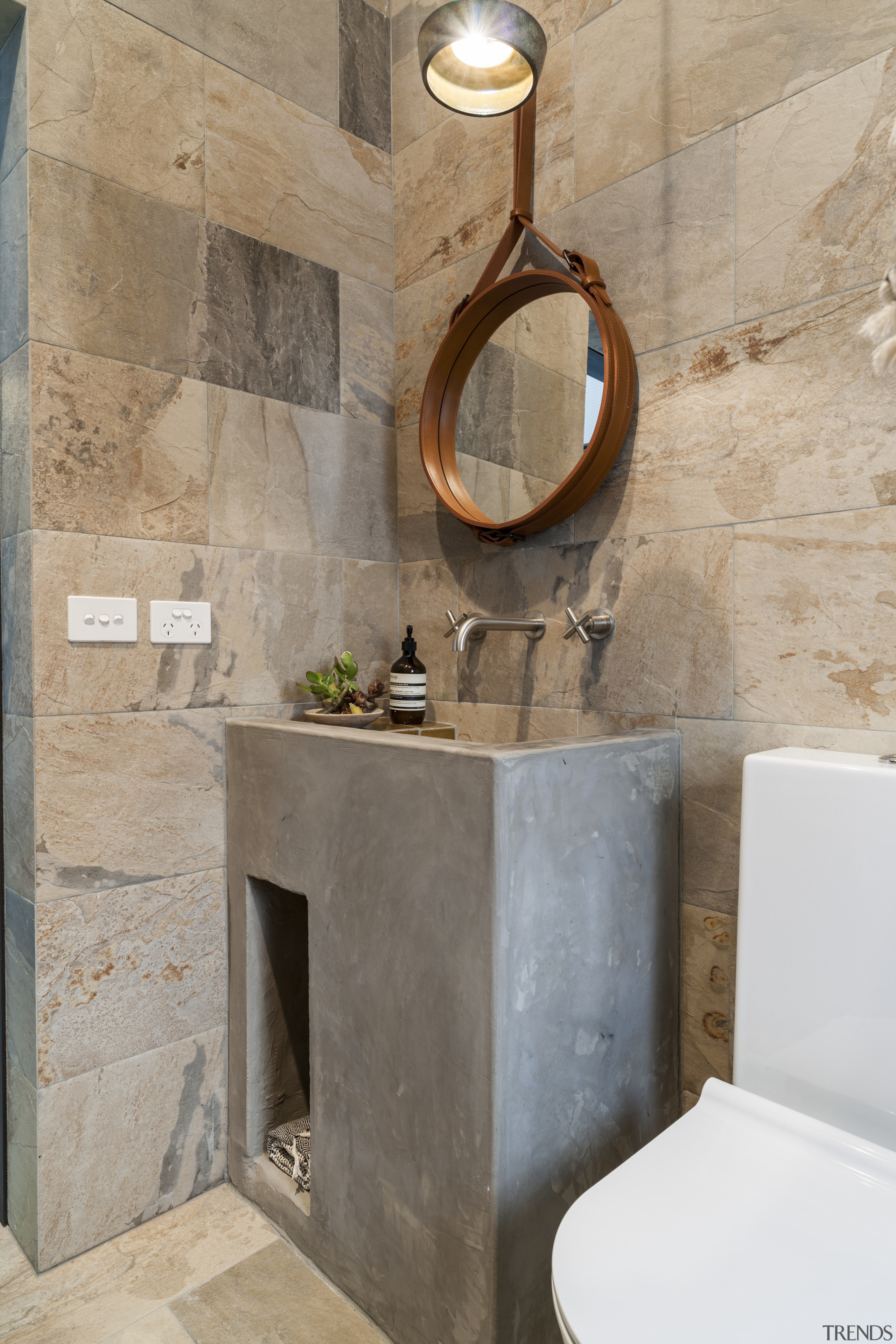 The powder room in this remodelled house features bathroom, ceramic, floor, plumbing fixture, sink, tap, tile, gray