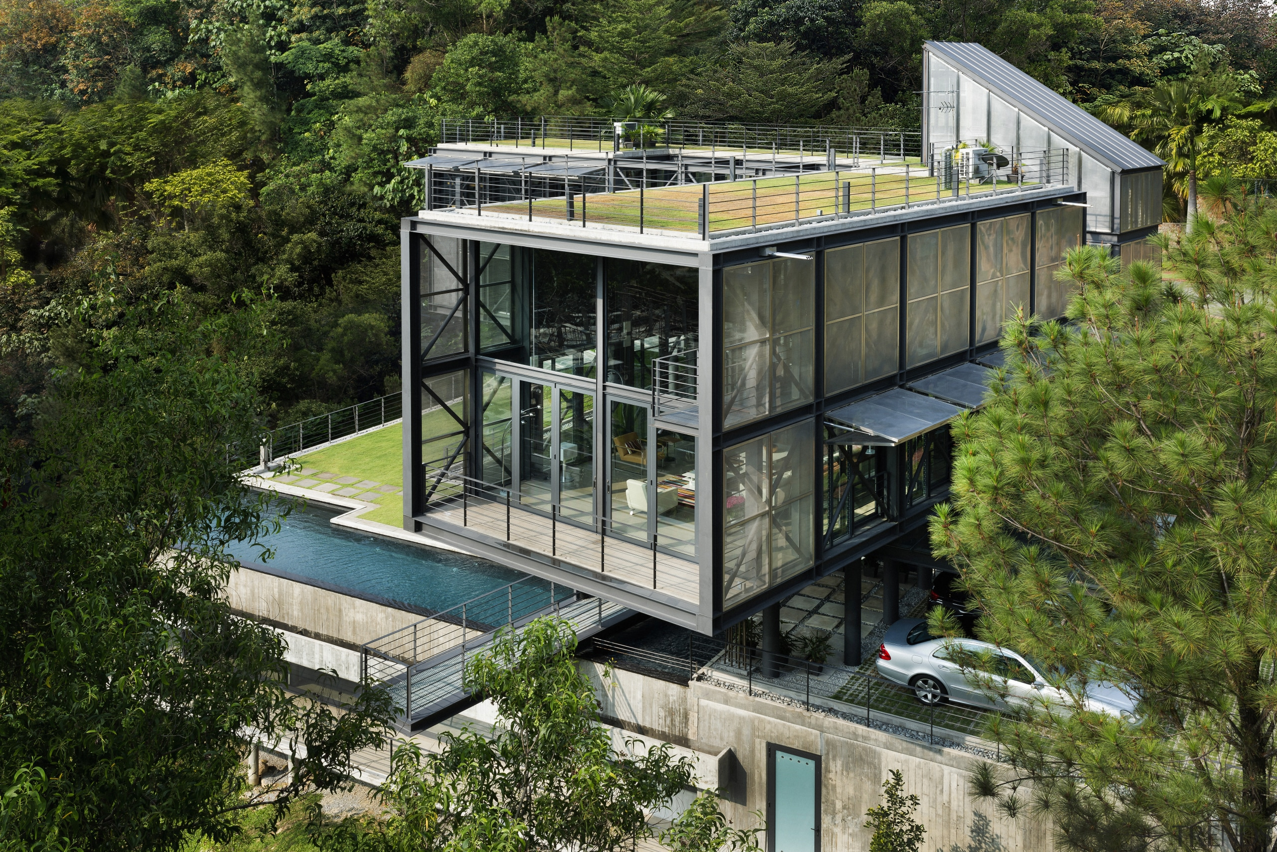 A covered parking bay leads under this house architecture, house, real estate, green