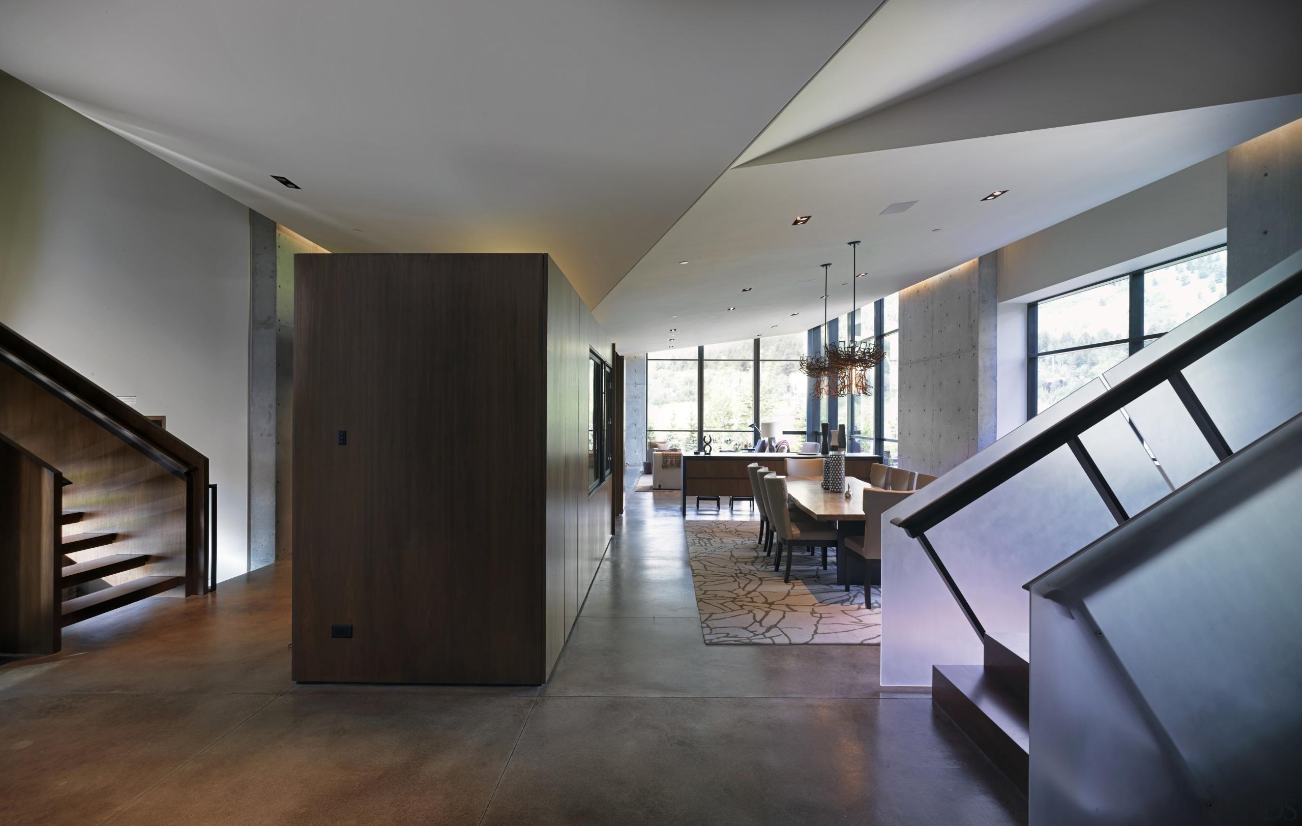 The inverted floating ceiling creates a modern aesthetic apartment, architecture, ceiling, condominium, daylighting, estate, floor, flooring, hardwood, house, interior design, living room, lobby, loft, property, real estate, room, stairs, window, wood, wood flooring, gray, black