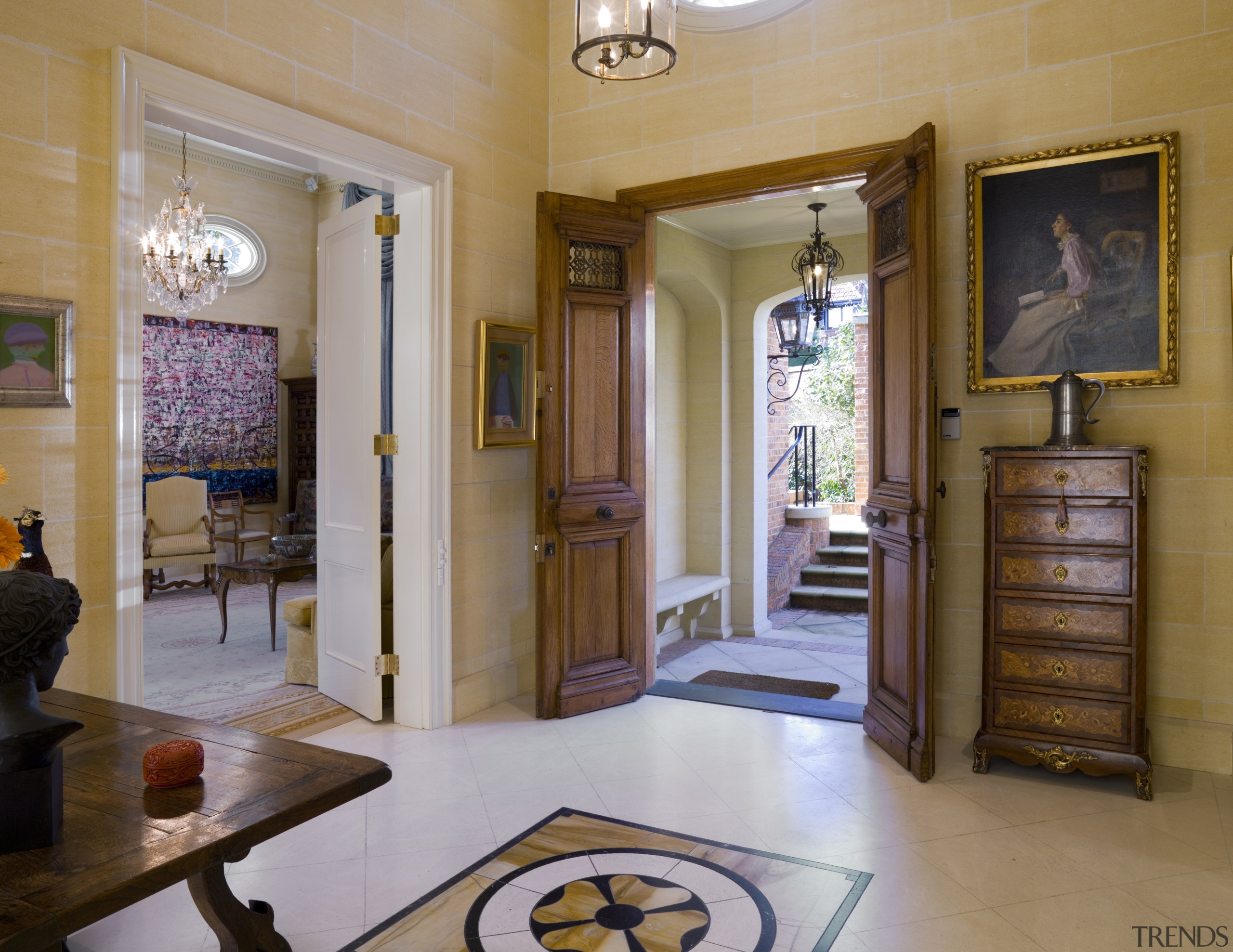 Other traditional French elements include the limestone floors ceiling, door, estate, floor, flooring, home, interior design, lobby, property, real estate, room, brown, gray