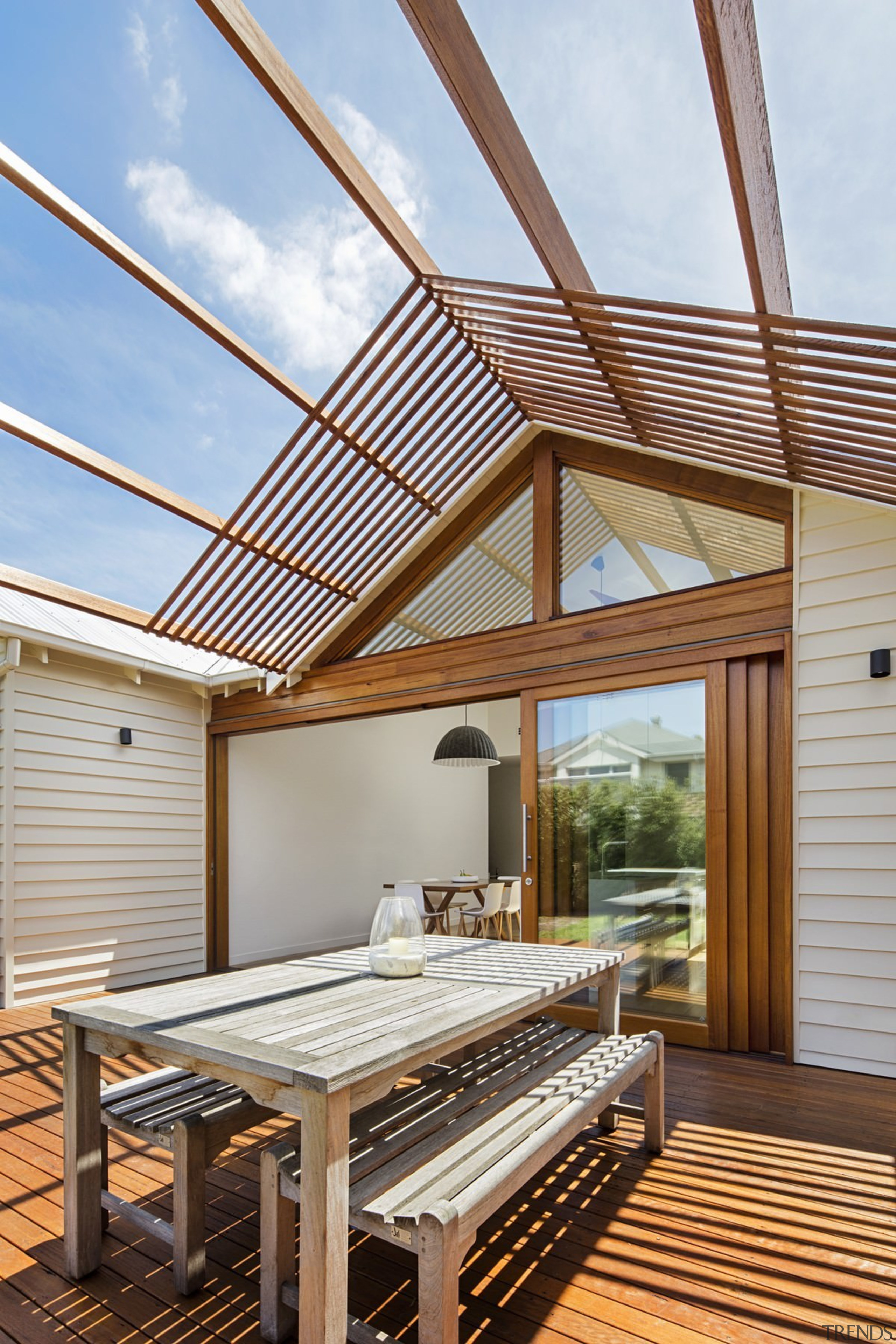 The kitchen and outdoor dining area are connected daylighting, outdoor structure, real estate, roof, wood, brown, white