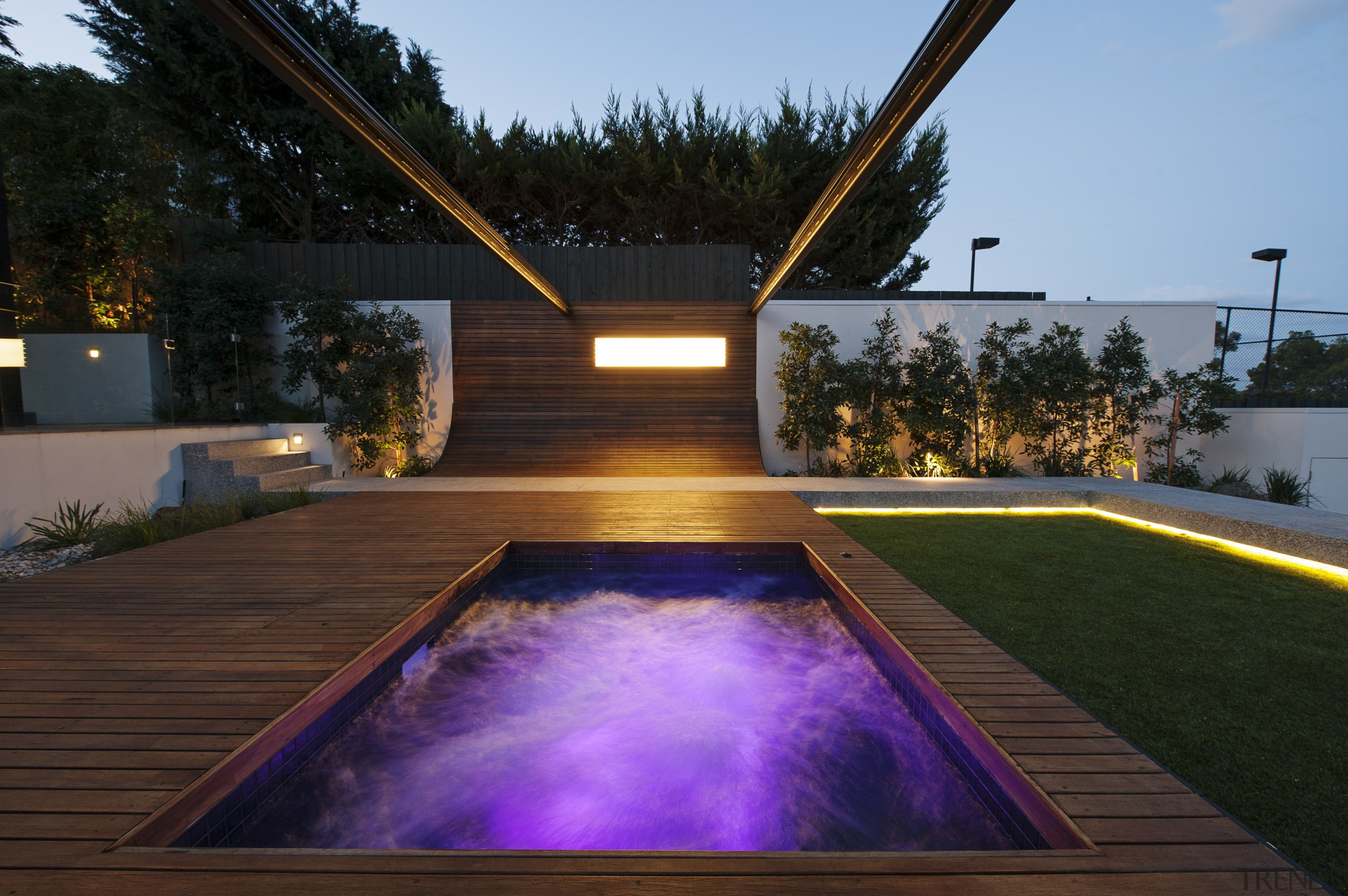 For this project, a steel arm rises up architecture, backyard, estate, home, house, landscape, landscape lighting, lighting, property, real estate, reflection, swimming pool, water, wood, black