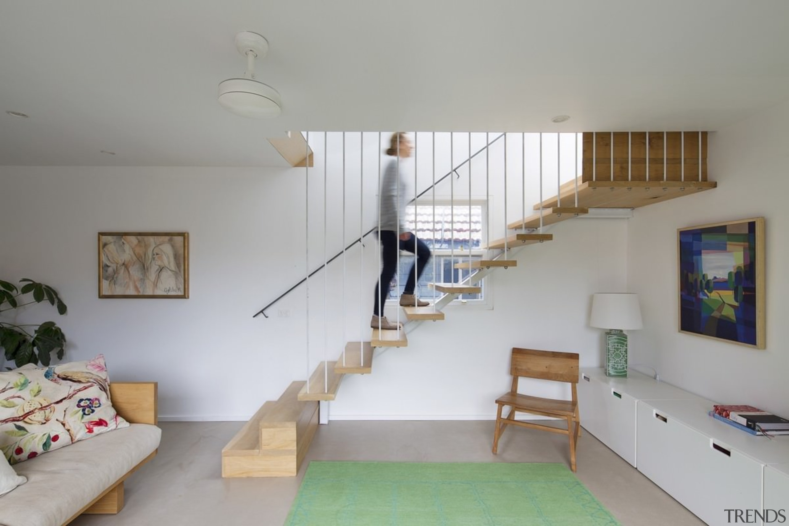 A floating stairway rises up to the second architecture, ceiling, daylighting, floor, furniture, handrail, home, house, interior design, living room, loft, real estate, room, stairs, wall, wood, gray