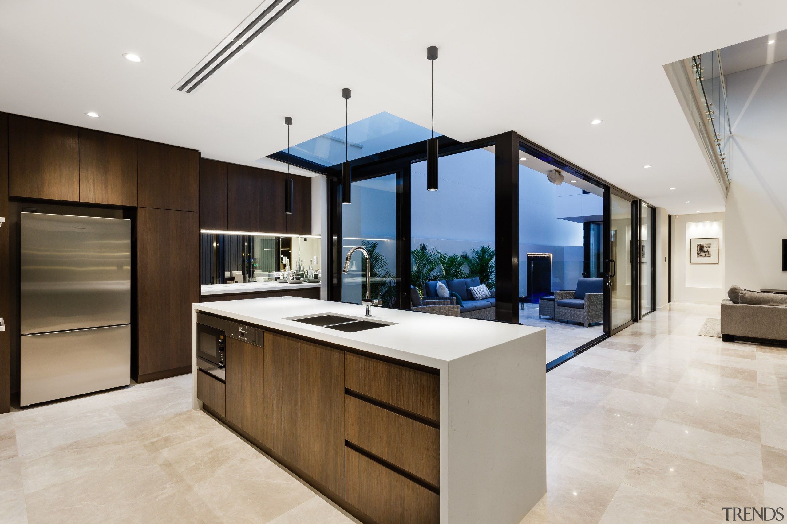 The island with waterfall benchtop in this on-show architecture, cabinetry, countertop, cuisine classique, interior design, kitchen, real estate, white