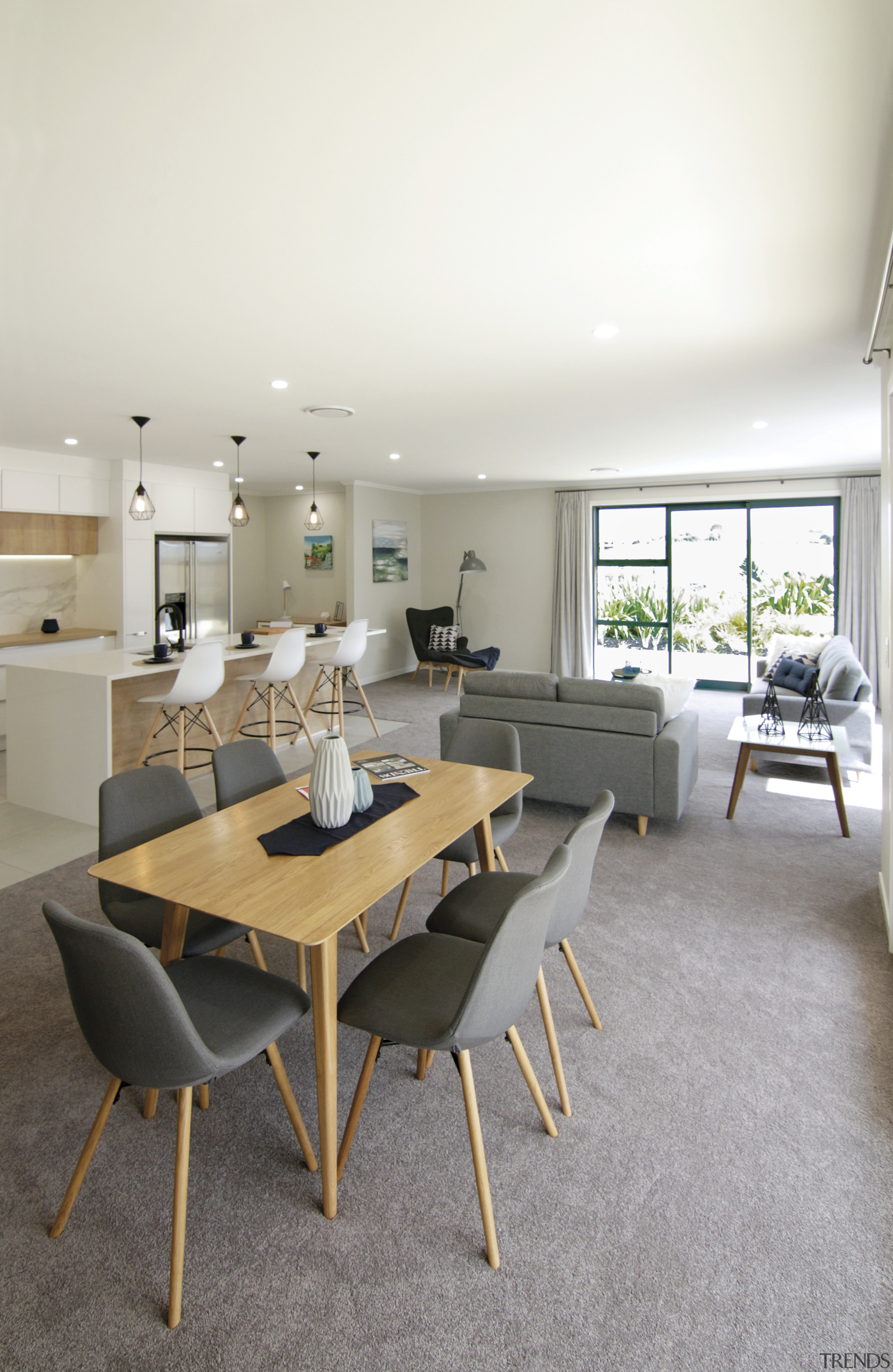 In this Orewa showhome by Fowler Homes, the interior design, living room, room, table, white, gray