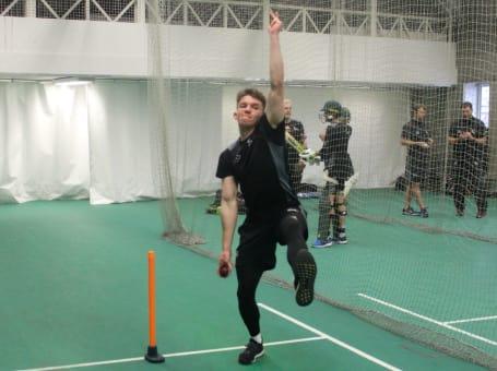 Matt Milnes bowls in nets