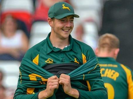 Matt Carter smiles green
