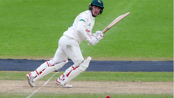 Tom Moores white kit batting