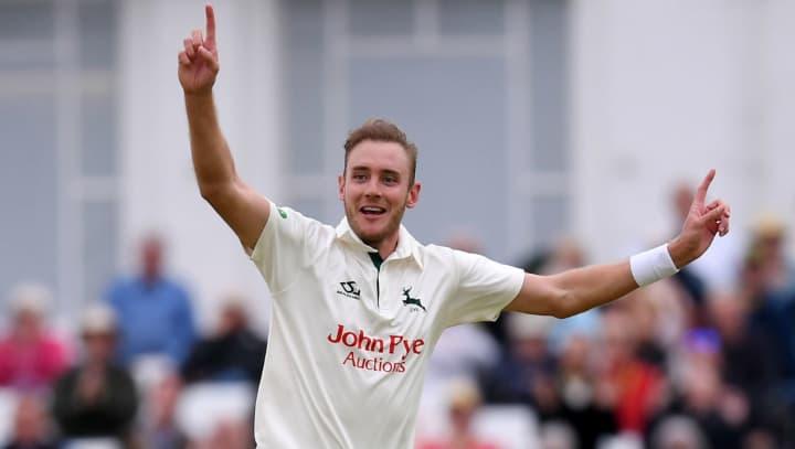 Stuart Broad bowl white kit celebrating
