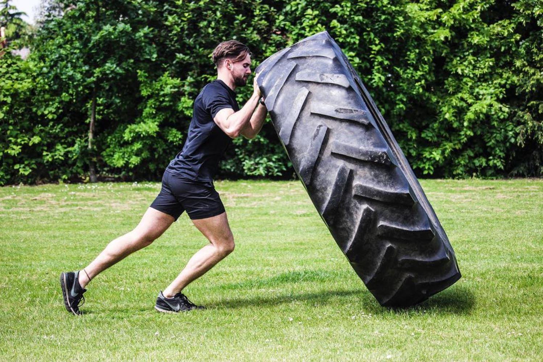 Jon flipping a giant tyre