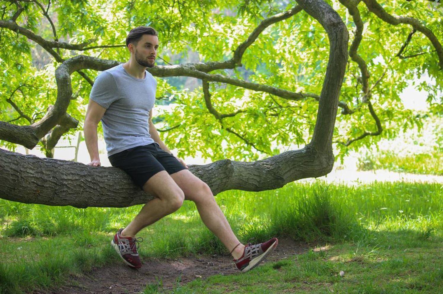 Jon sitting on a large branch