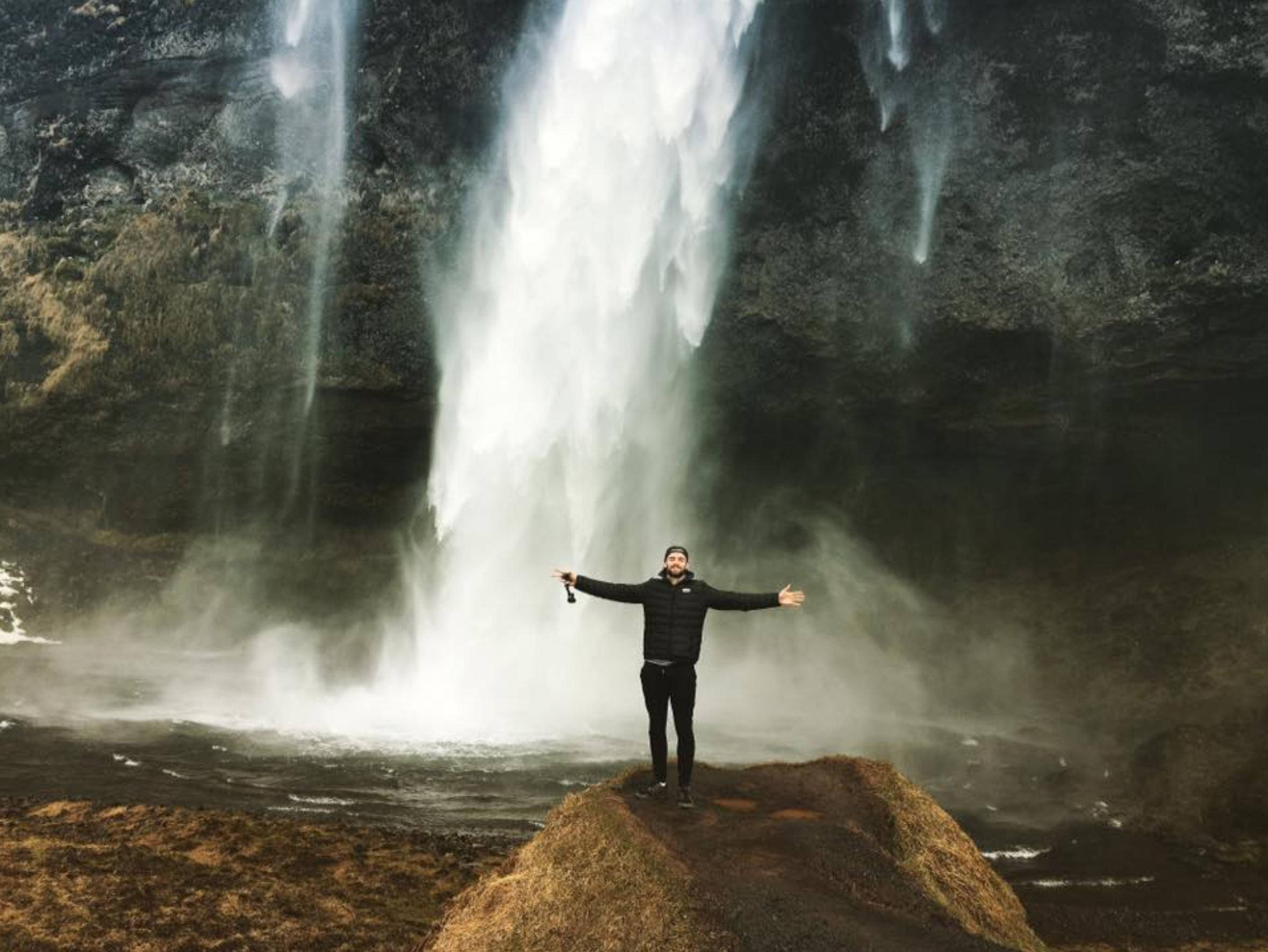 Standing under a waterfall