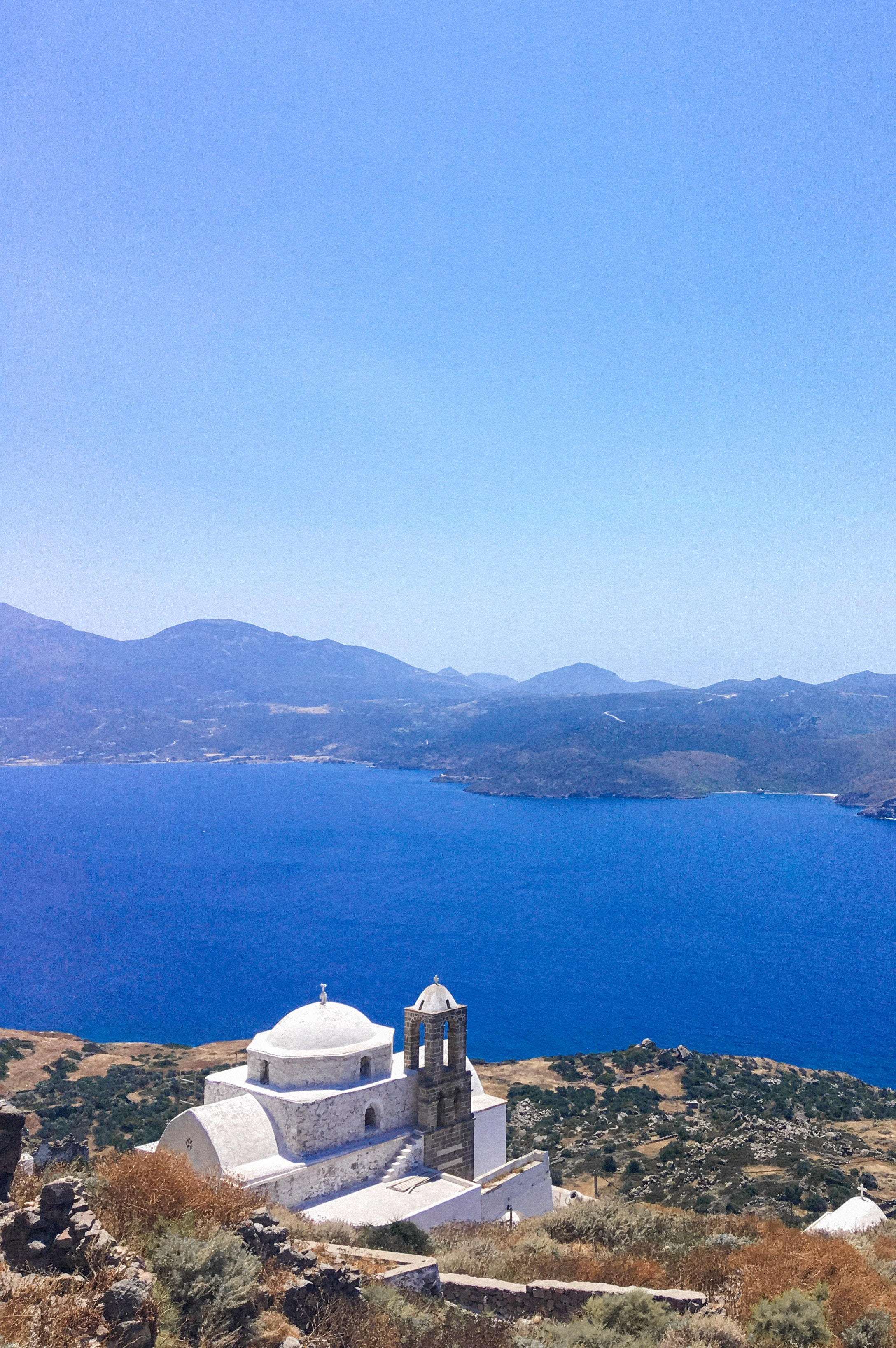View of a Greek Orthodox church while climbing to Plaka Castle