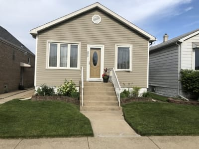 Bright Well Maintained house in Jefferson Park.  Possible in-law arrangement