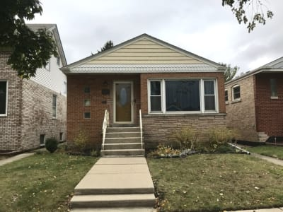 RAISED RANCH OPPORTUINTY IN NORWOOD PARK WITH HARDWOOD FLOORS