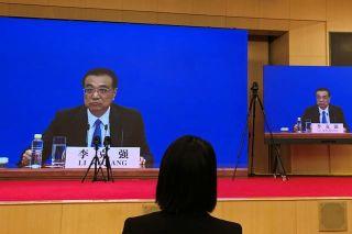 路透综述:山雨欲来风满楼 应对后疫情时代中国总理称政策储备足够