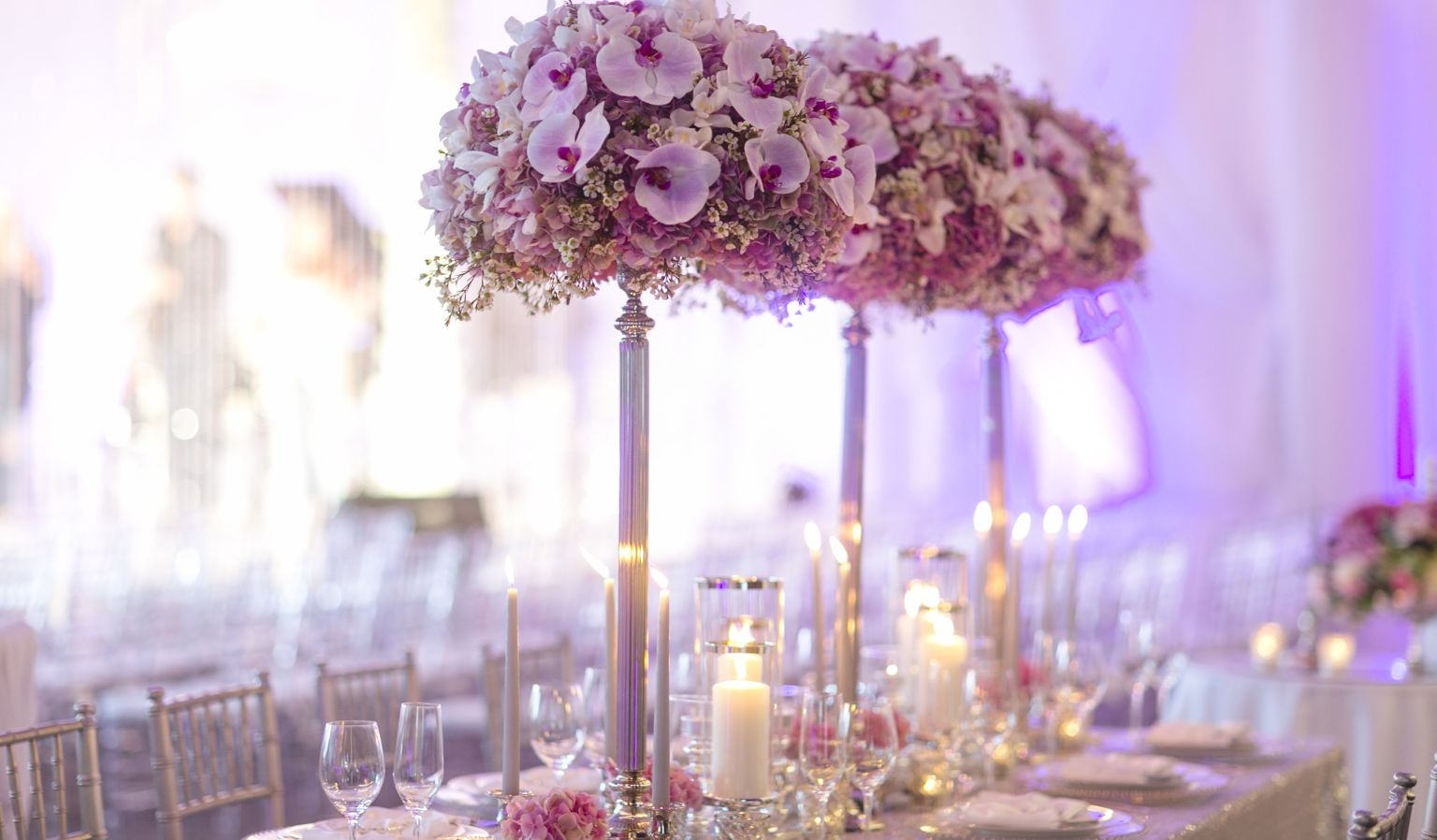 hotel interior wedding reception with flowers, candles