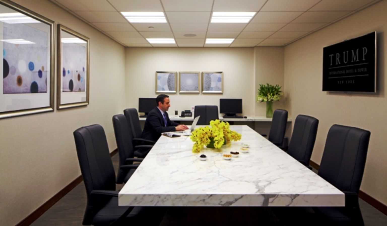 Man Sitting At Meeting Table