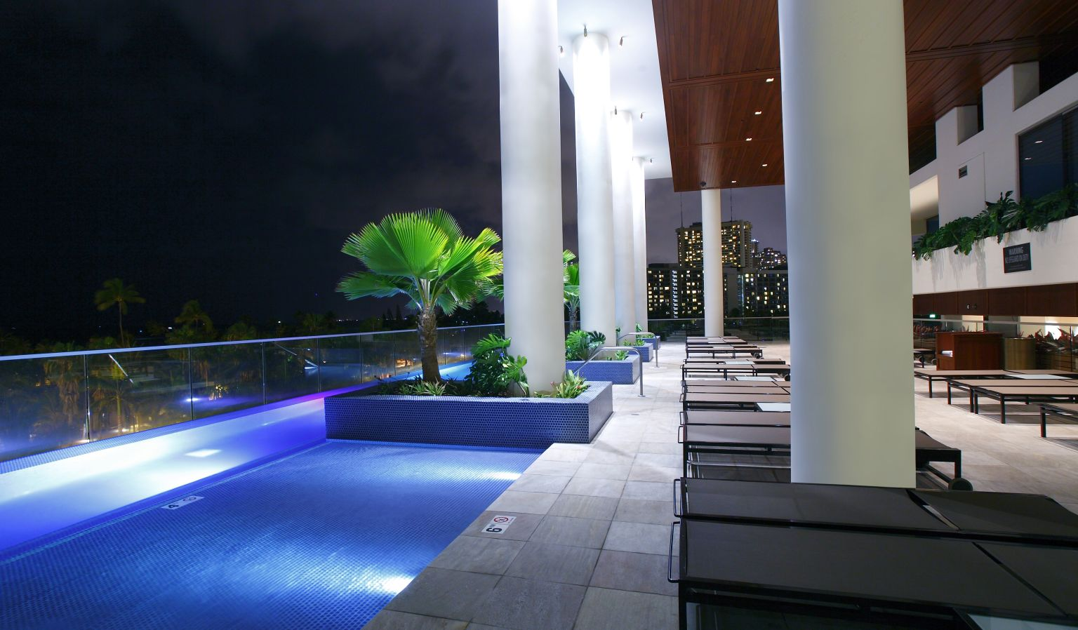 Outdoor Pool & Lounge Chairs at Night
