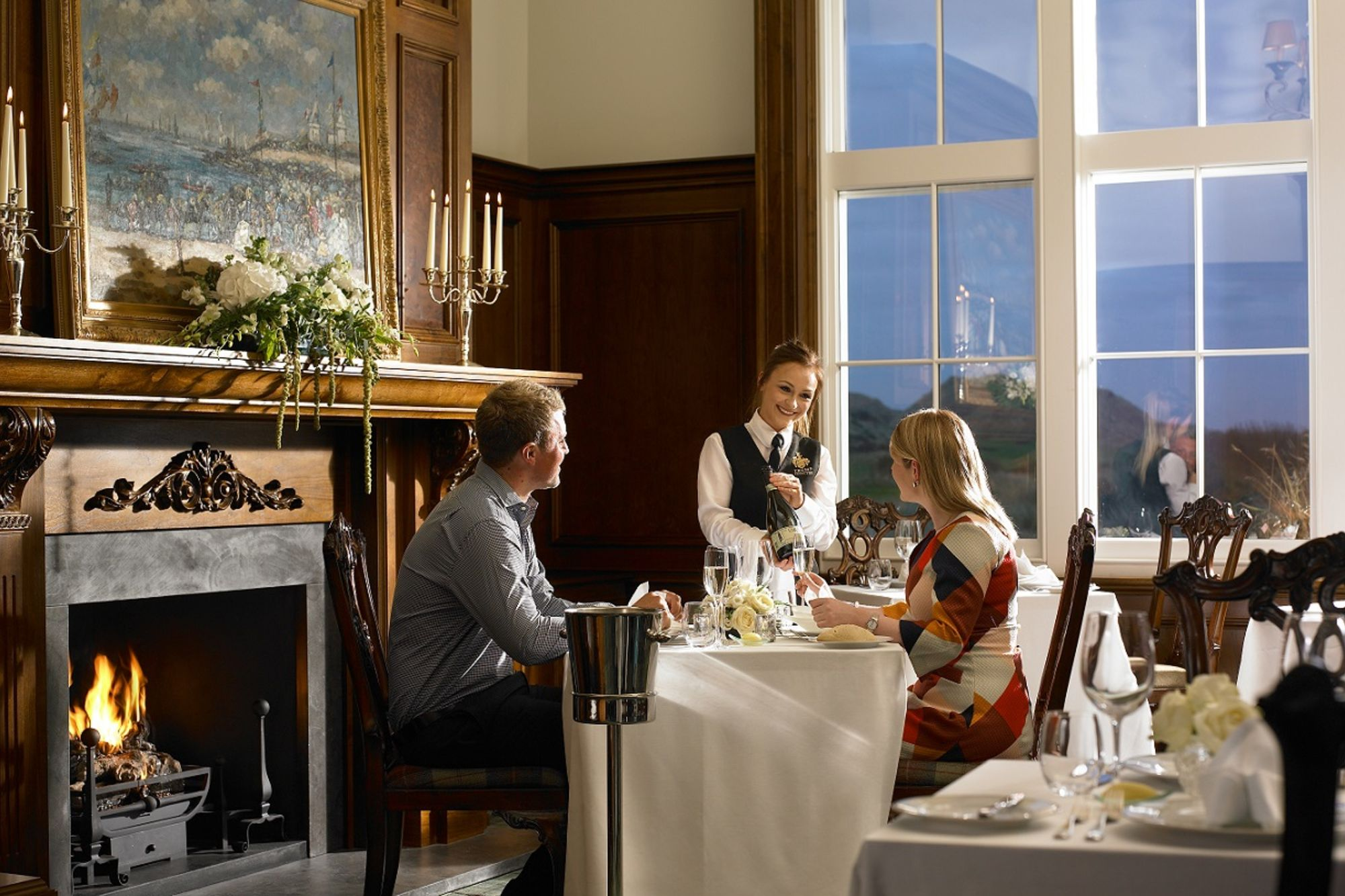 MacLeod House dining room with server presenting wine