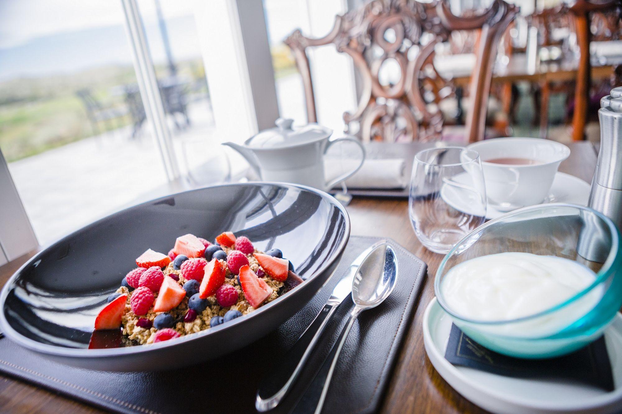 Bowls of granola/fruit and yogurt