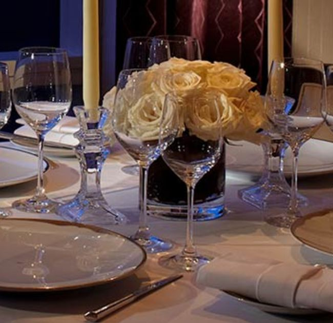 Flower Centerpiece And Glassware On Table