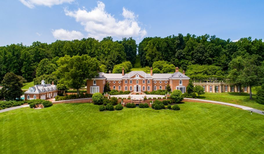 Albemarle estate house exterior surrounded by trees and greens