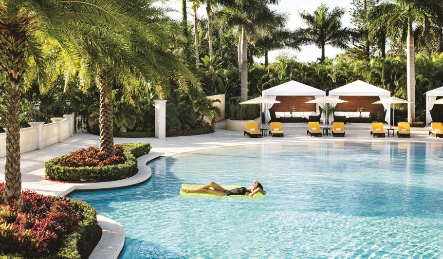 Trump Doral Royal Palm Pool with model on pool float