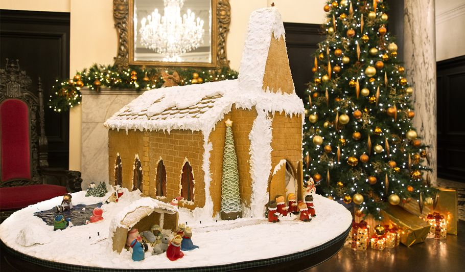 Chapel Gingerbread House in front of Christmas Tree