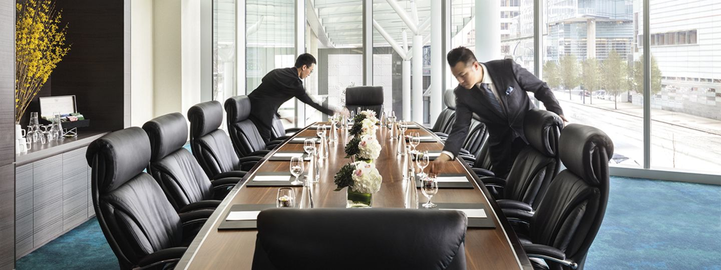 Men Setting Up Meeting Tables