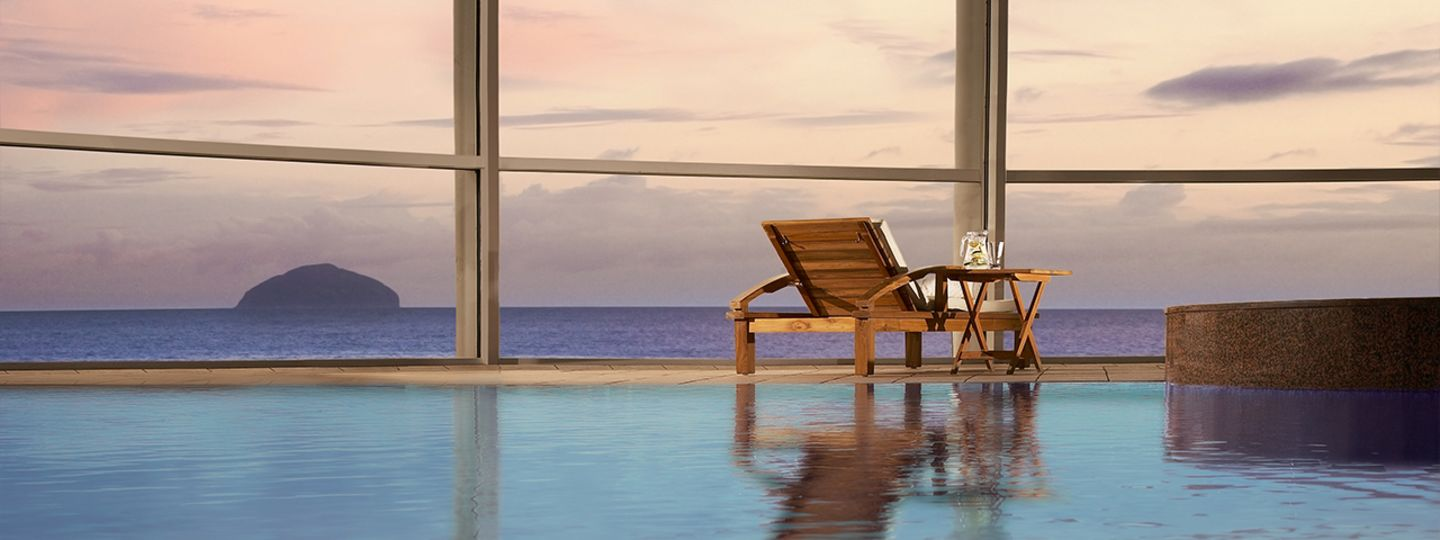 Pool with a Chair Overlooking the Ocean