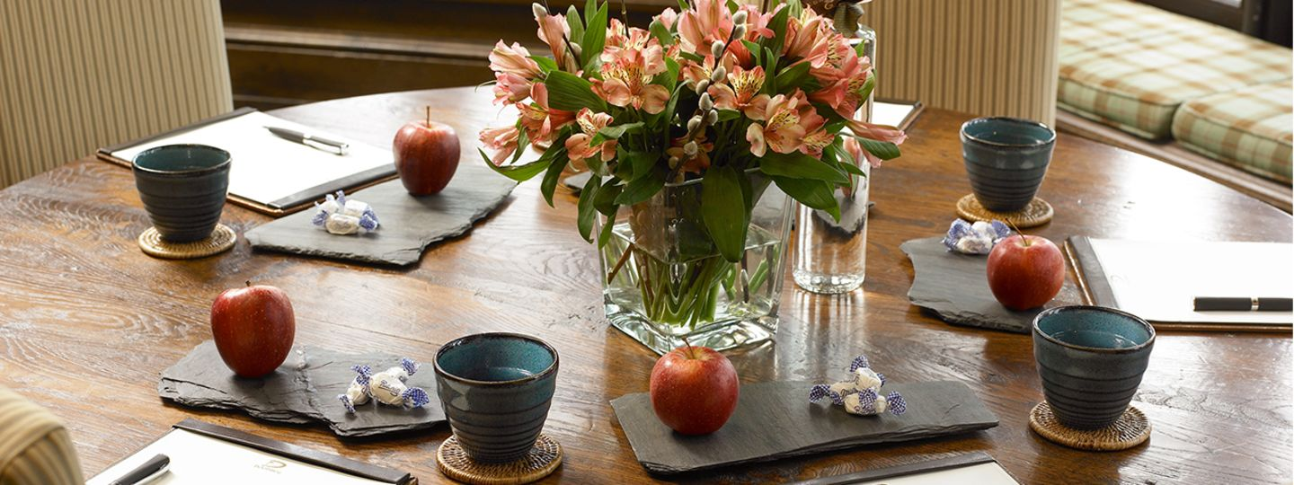 Table with Flowers and Apples